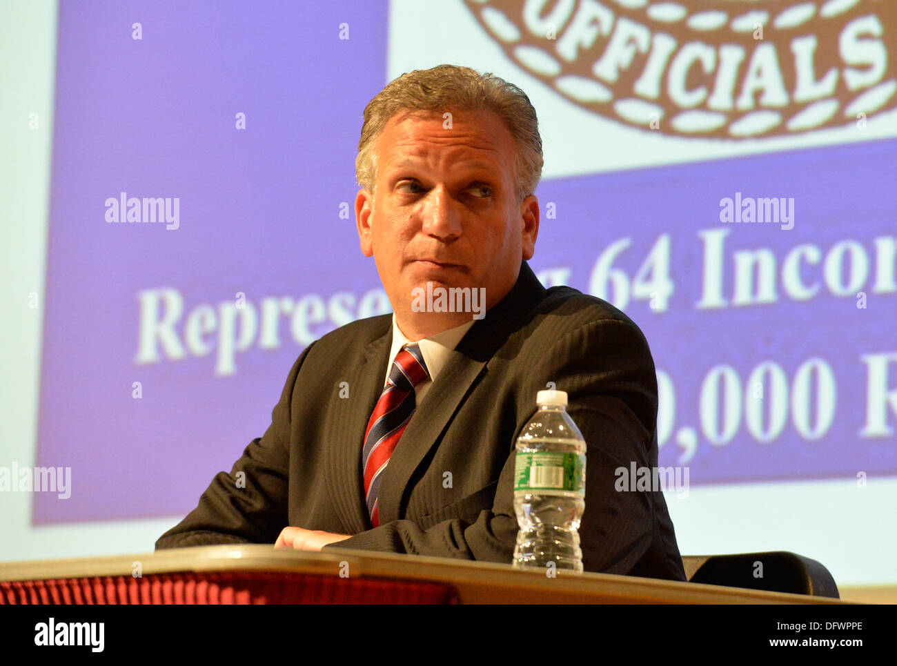 Old Westbury, New York, U.S. 8th October 2013. Republican EDWARD MANGANO, the Nassau County Executive, debates with former Nassau County Executive Suozzi n a debate hosted by the Nassau County Village Officials Association, representing 64 incorporated villages with 450,000 residents, as the opponents face a rematch in the 2013 November elections. Credit:  Ann E Parry/Alamy Live News - Stock Image