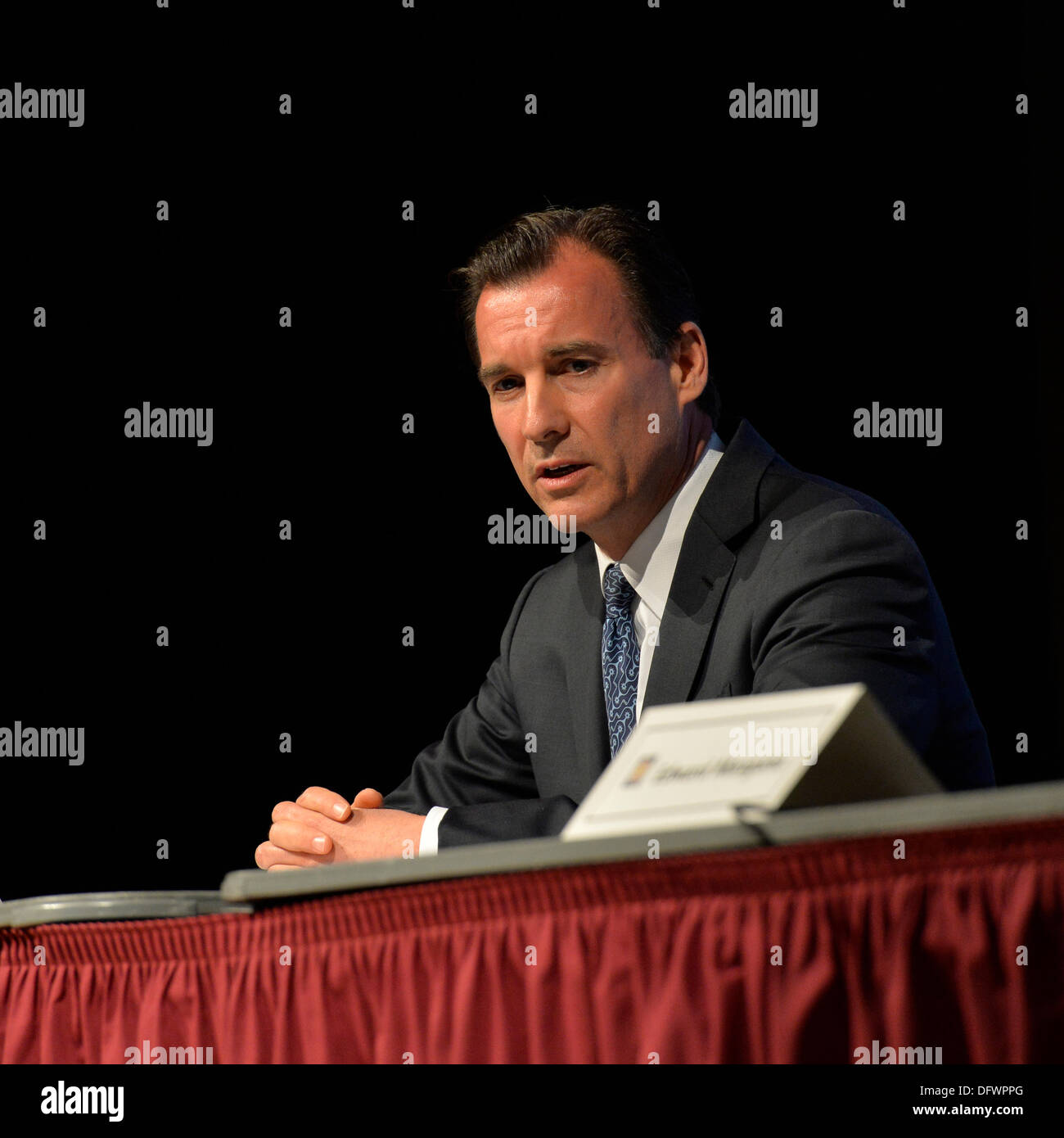 Old Westbury, New York, U.S. 8th October 2013. Democrat THOMAS SUOZZI, the former Nassau County Executive, debates with current Nassau County Executive Mangano at debate hosted by the Nassau County Village Officials Association, representing 64 incorporated villages with 450,000 residents, as the opponents face a rematch in the 2013 November elections. Credit:  Ann E Parry/Alamy Live News - Stock Image