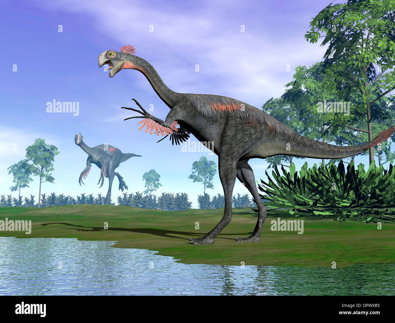 Two Gigantoraptor dinosaurs standing in nature with trees next to water. Stock Photo
