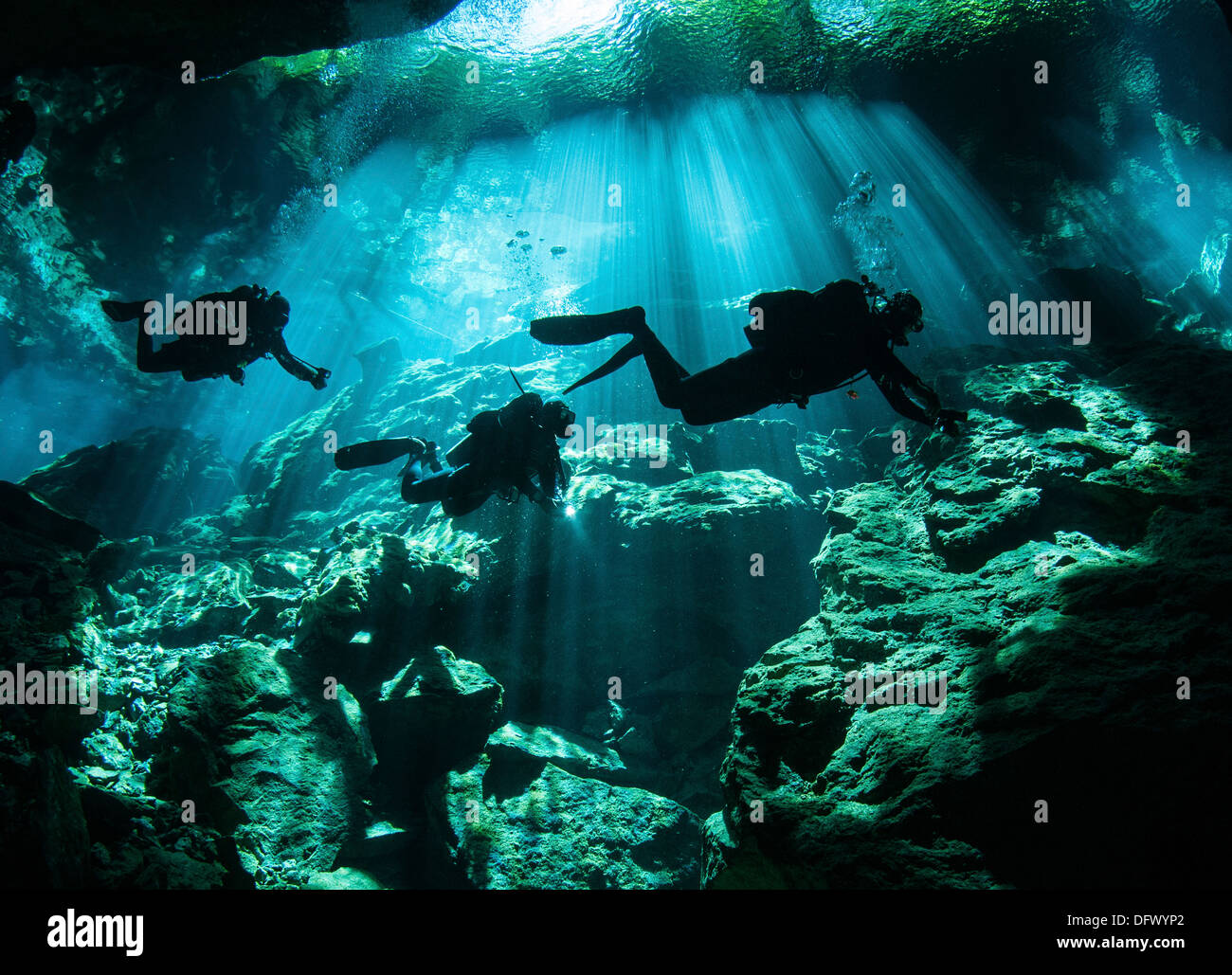 Diver enters the cavern system at Chac Mool cenote in the Riviera Maya area of Mexico's Yucatan Peninsula. - Stock Image