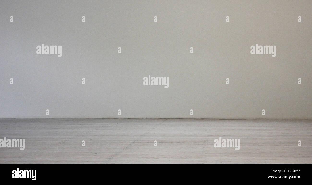 Monochromatic Wall and Wood Floor - Stock Image