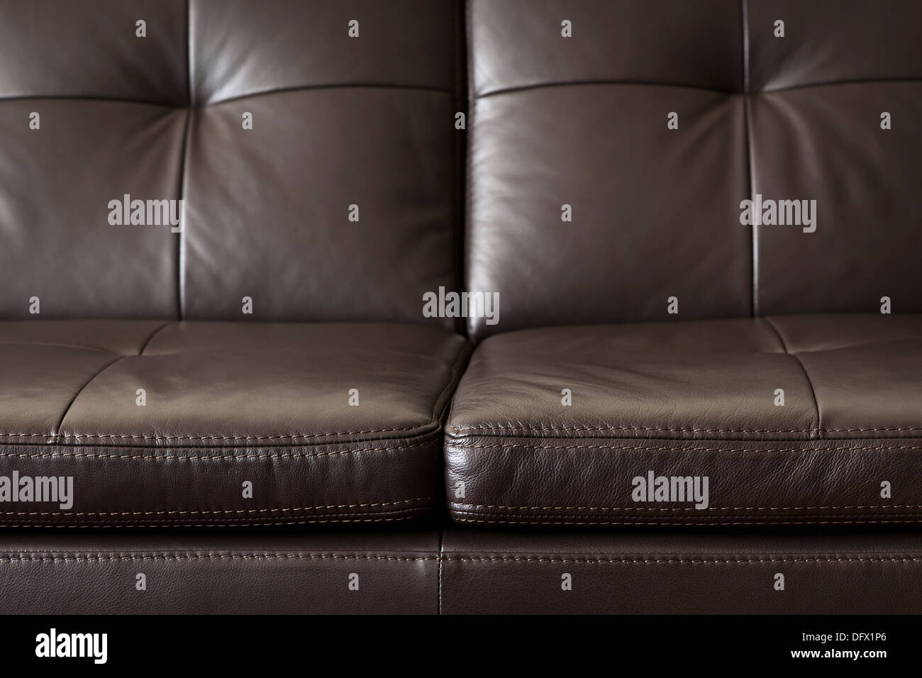 Closeup of luxurious expensive brown leather couch - Stock Image