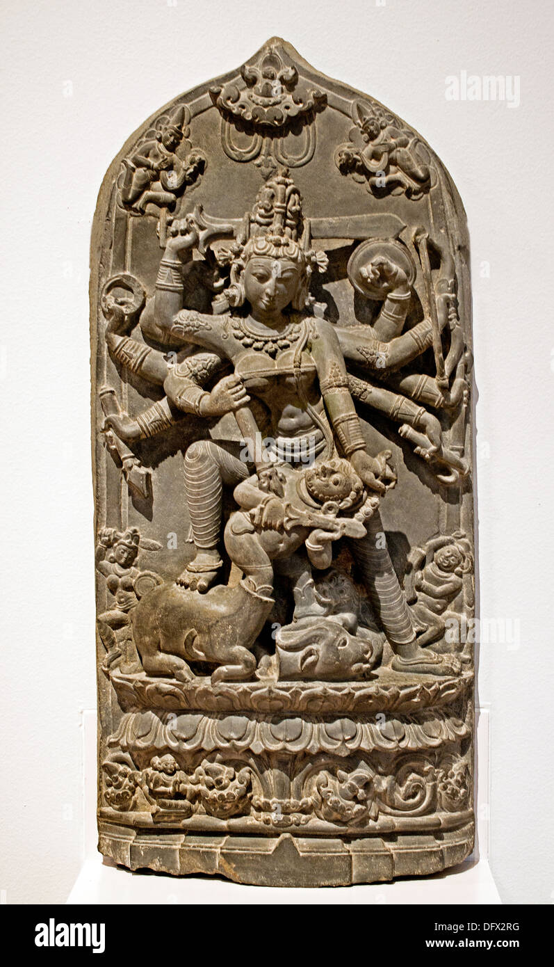 Durga ( Hindu goddess ) killing the buffalo demon 11th century stone Pala style Bangladesh Museum sculpture statue - Stock Image