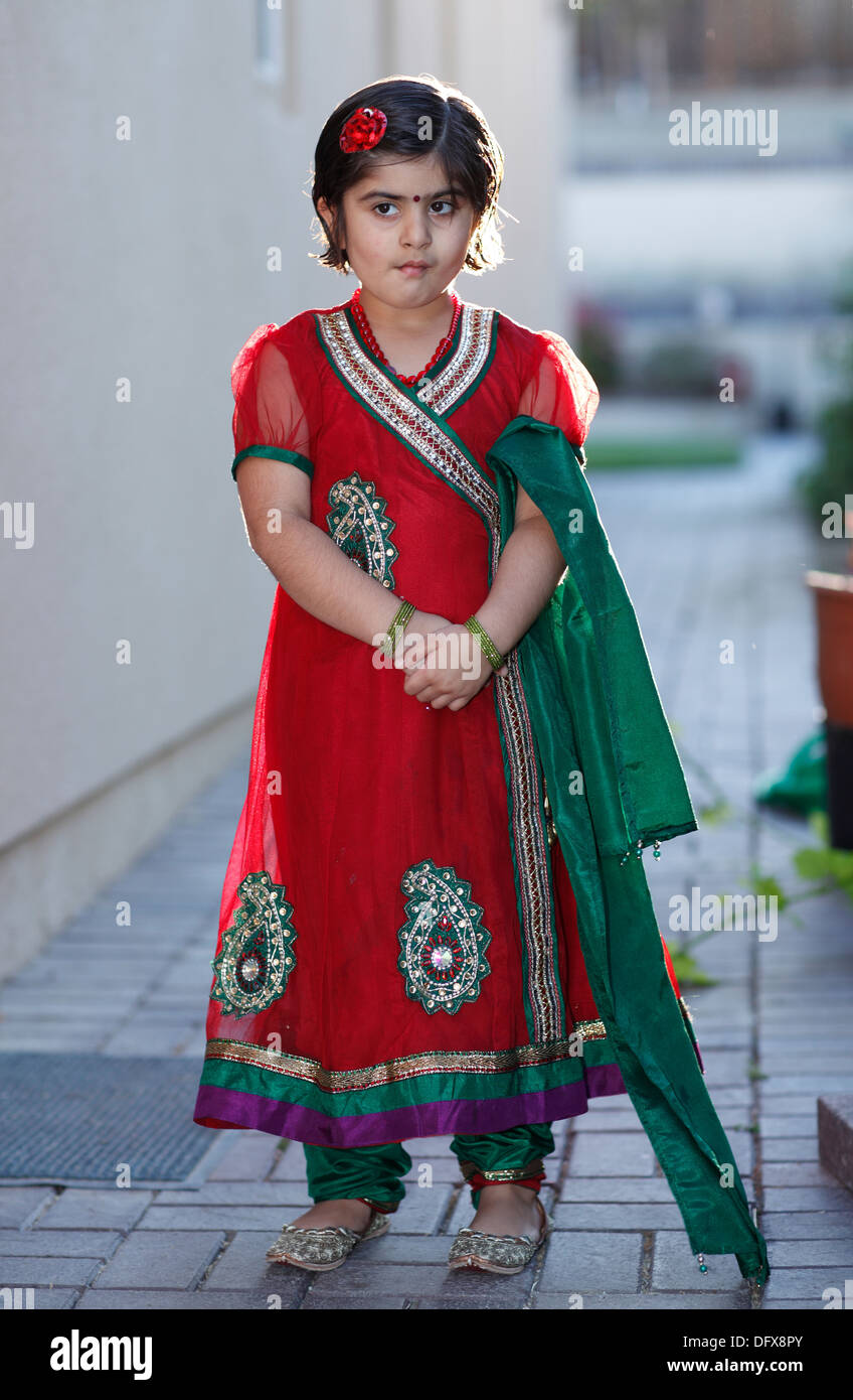 Portrait of an indian american girl playing outdoors - Stock Image