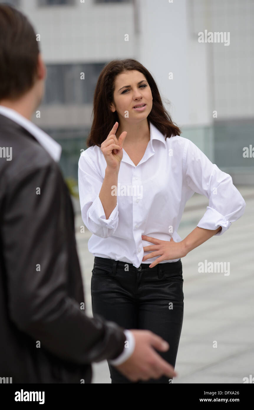 emotional discussion between men and women - Stock Image