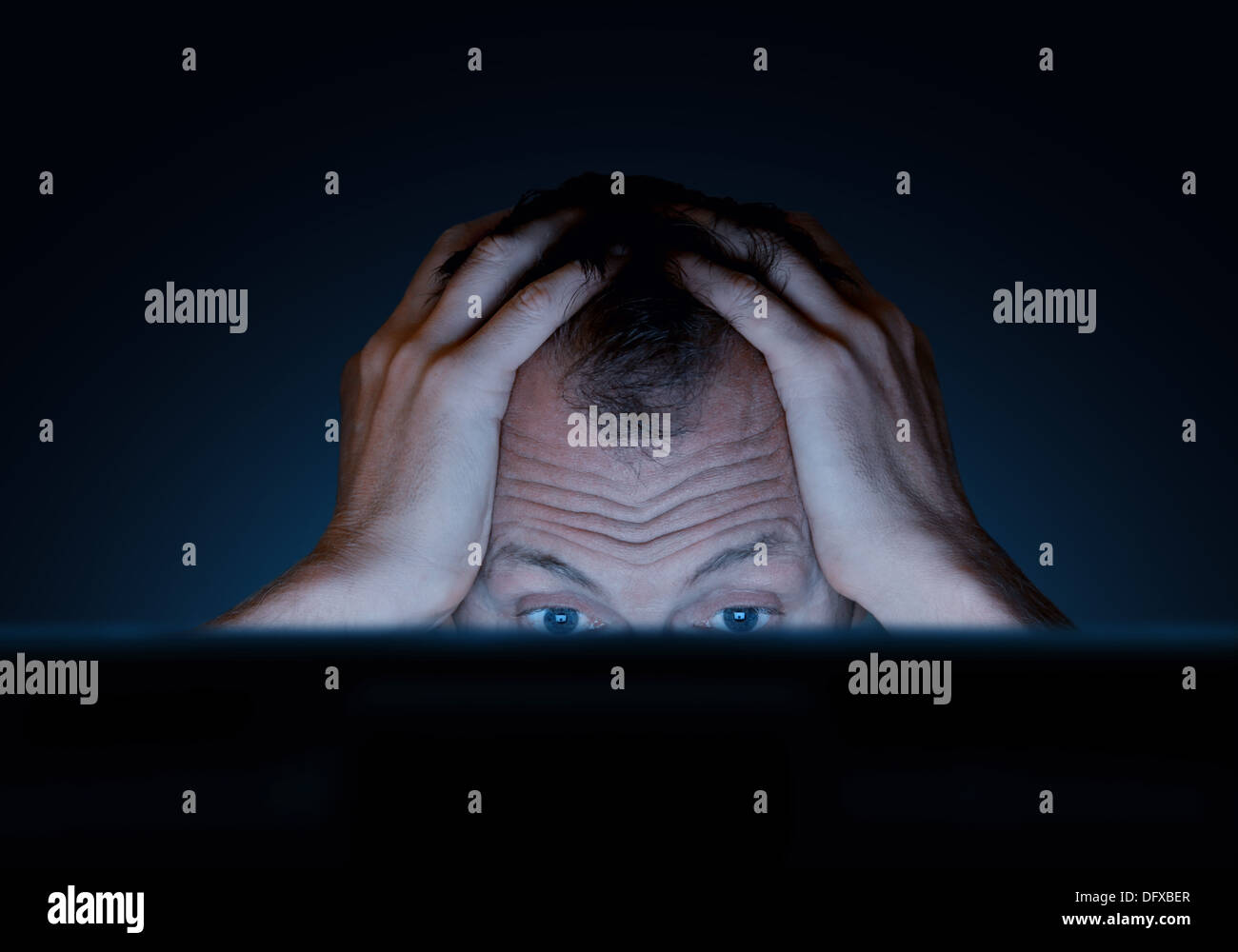 challenges of working at a computer - Stock Image