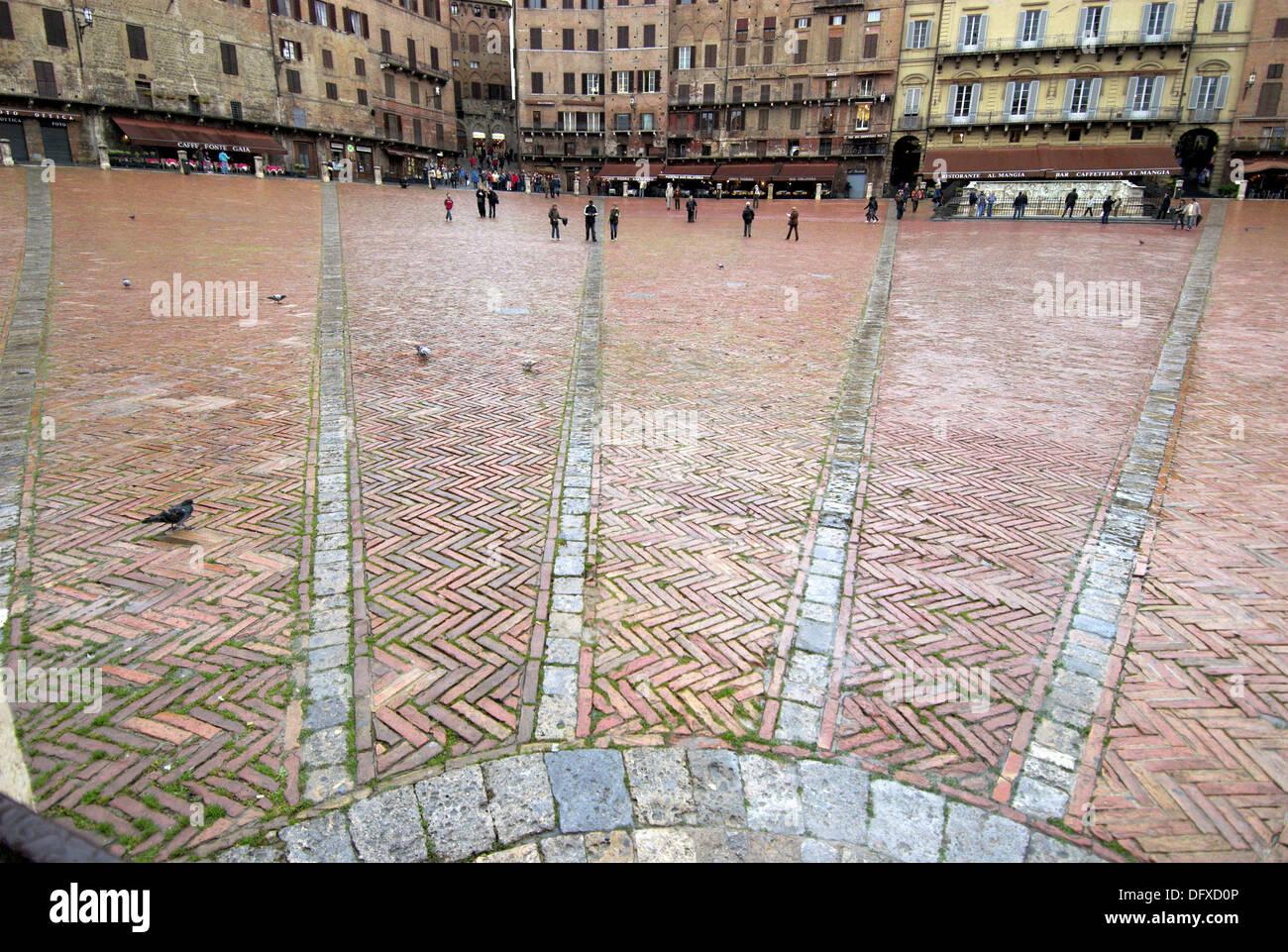 Siena, Piazza del Campo, pavement, rain, wetness, Tuscany, Italy - Stock Image