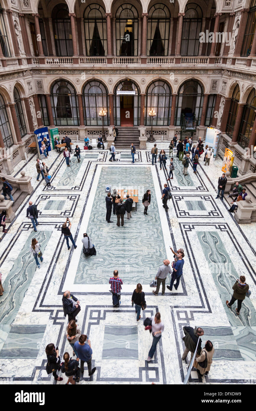 Visitors walk around the Durbar Court designed by Matthew Digby Wyatt within the Foreign and Commonwealth Office, Stock Photo