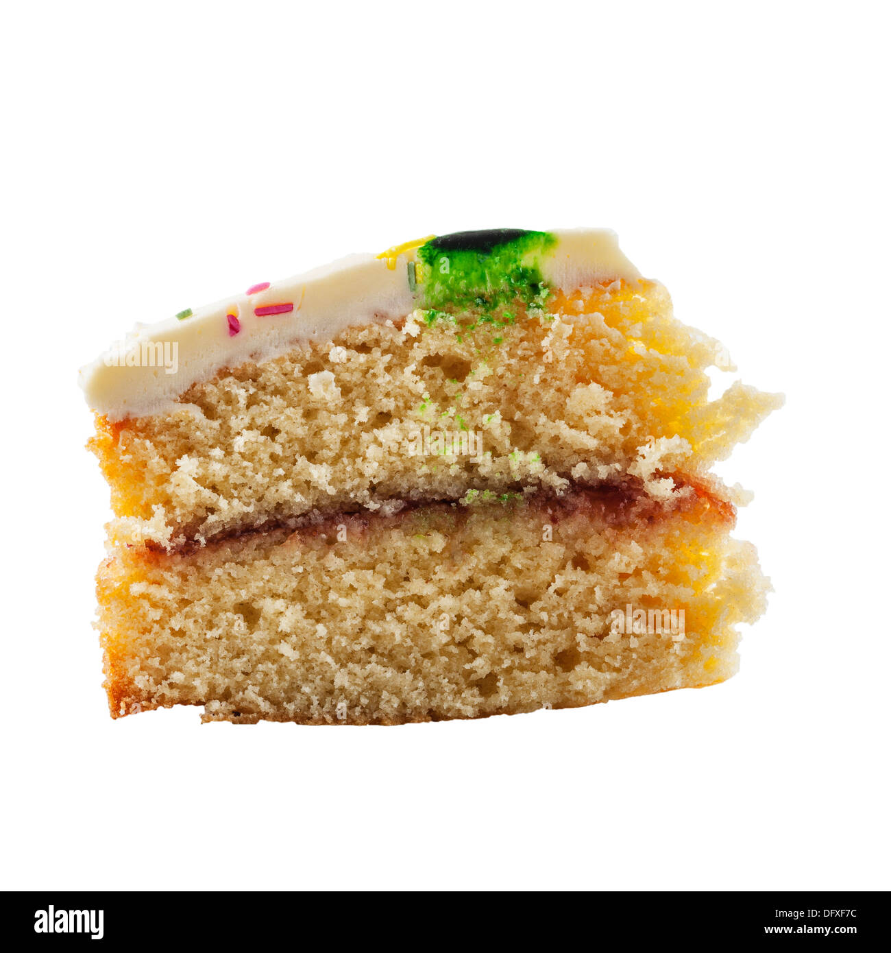 A slice of homemade Victoria sponge cake on a white background - Stock Image