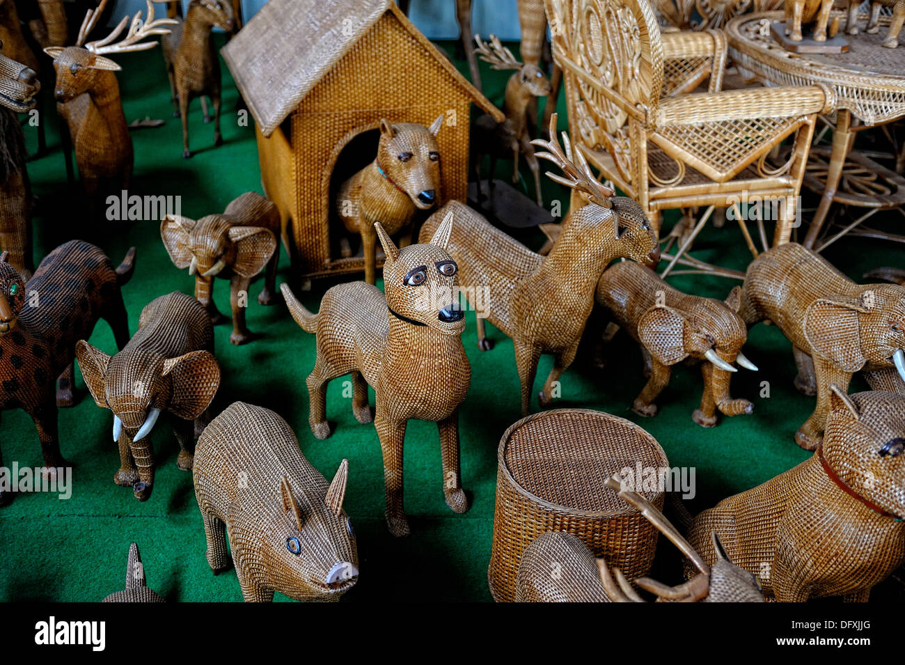 Animal wicker work on display in Camacha Madeira focus is centre on dogs head - Stock Image