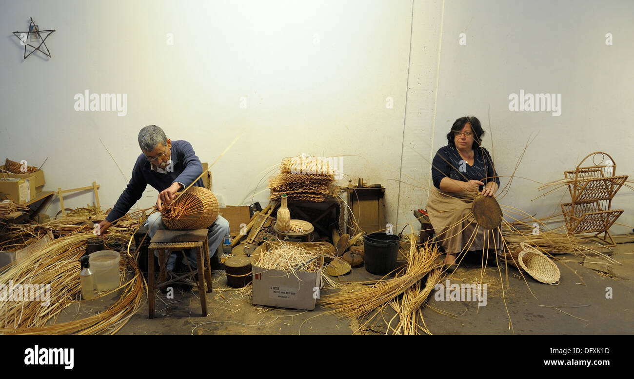 2 Basket weaver at work in the factory shop in Camacha Madeira Portugal - Stock Image