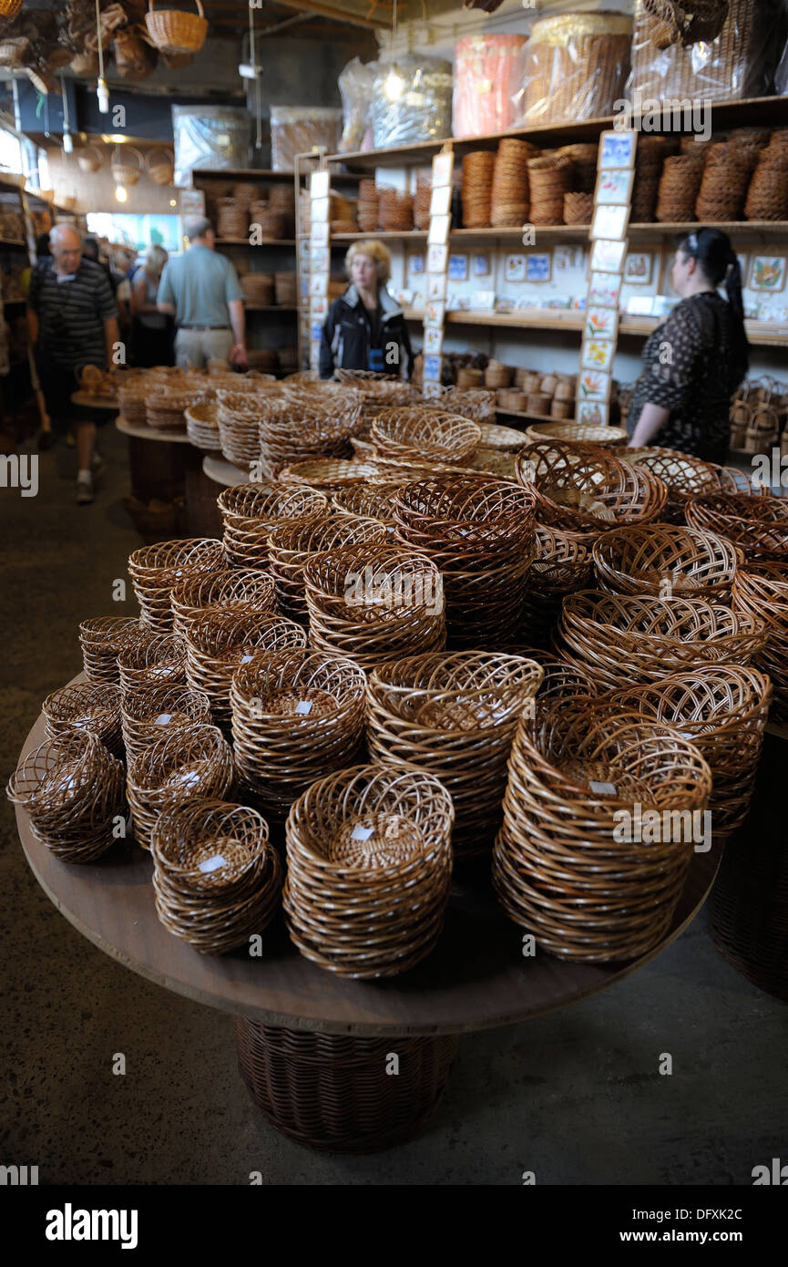 Small wicker basket on sale in a factory shop Camacha Madeira Portugal - Stock Image