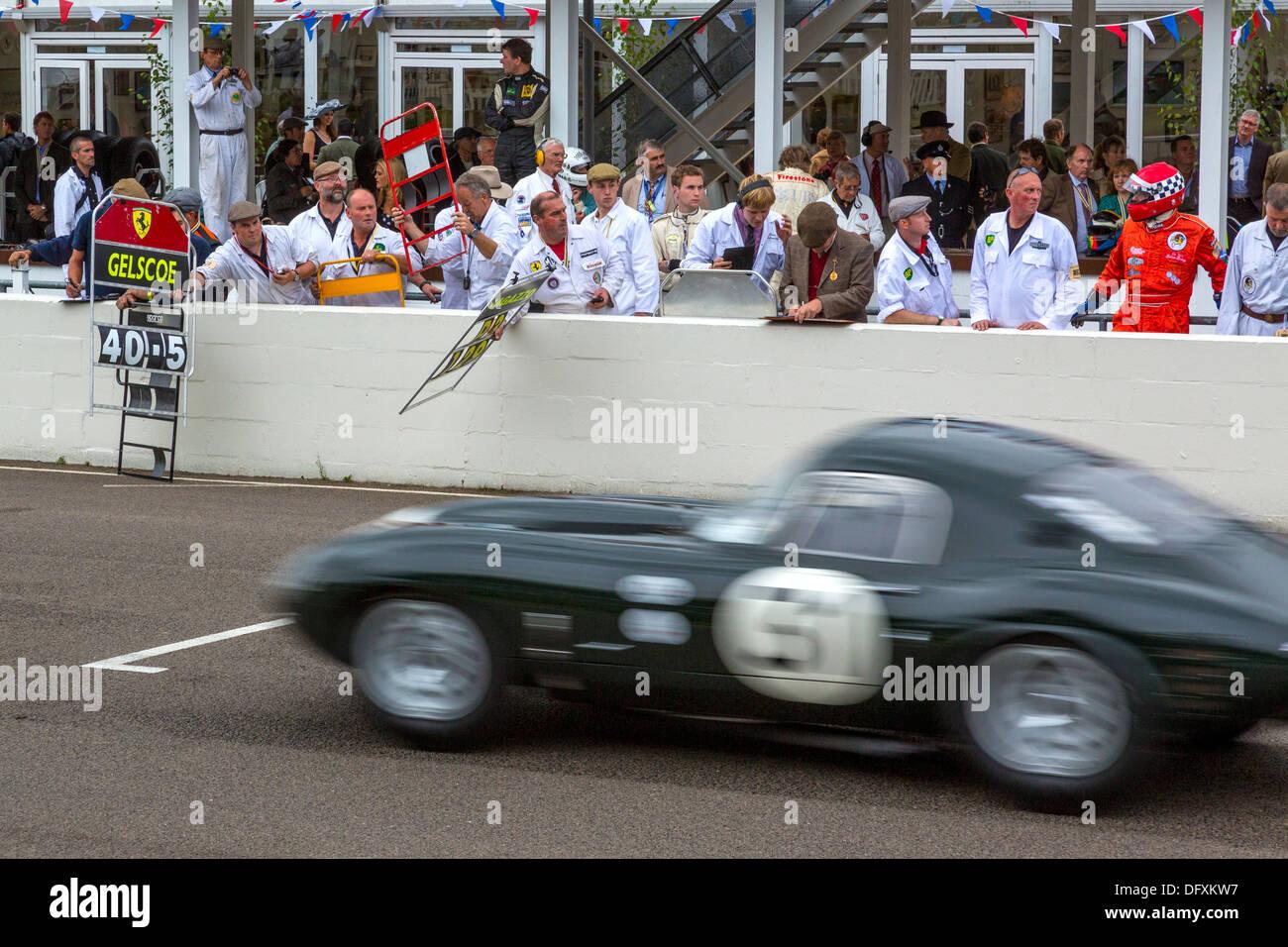 1963 Jaguar E-Type lightweight 'Lowdrag' passes the pits during the 2013 Goodwood Revival, Sussex, UK. RAC TT Celebration race. - Stock Image