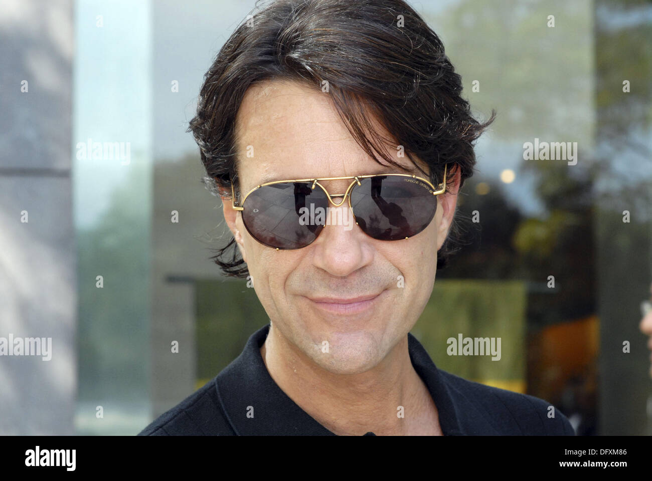 40-45 year old caucasian male, wearing sunglasses, close - up - Stock Image