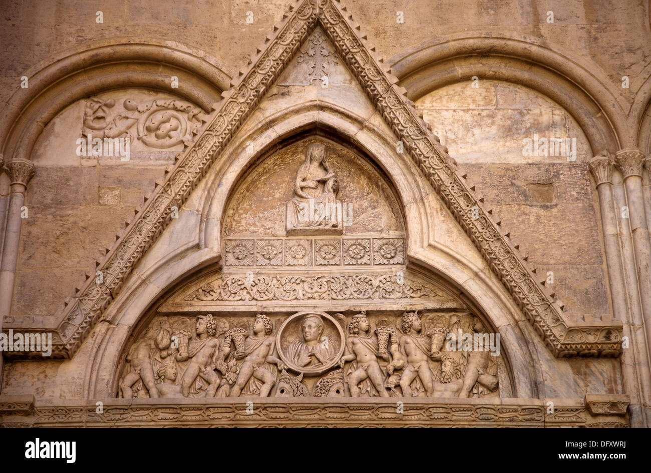 Detailed Stone Doorway Pediment on side of Cathedral of Cagliari on Via Fossario in Cagliari - Sardinia - Stock Image