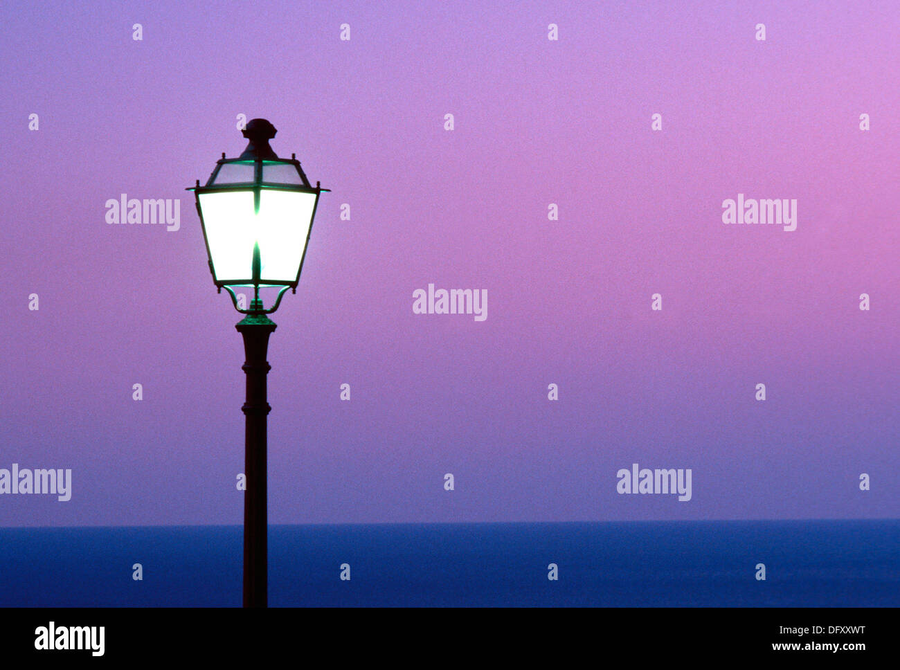 Lantern in the blue hour by the sea - Stock Image