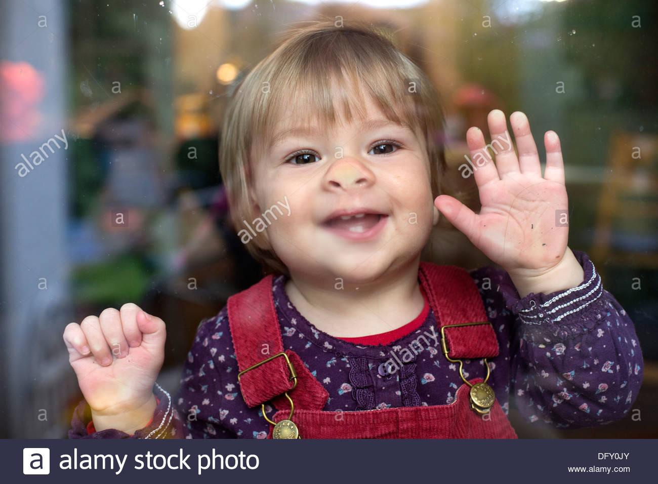 Child behind a window pane - Stock Image