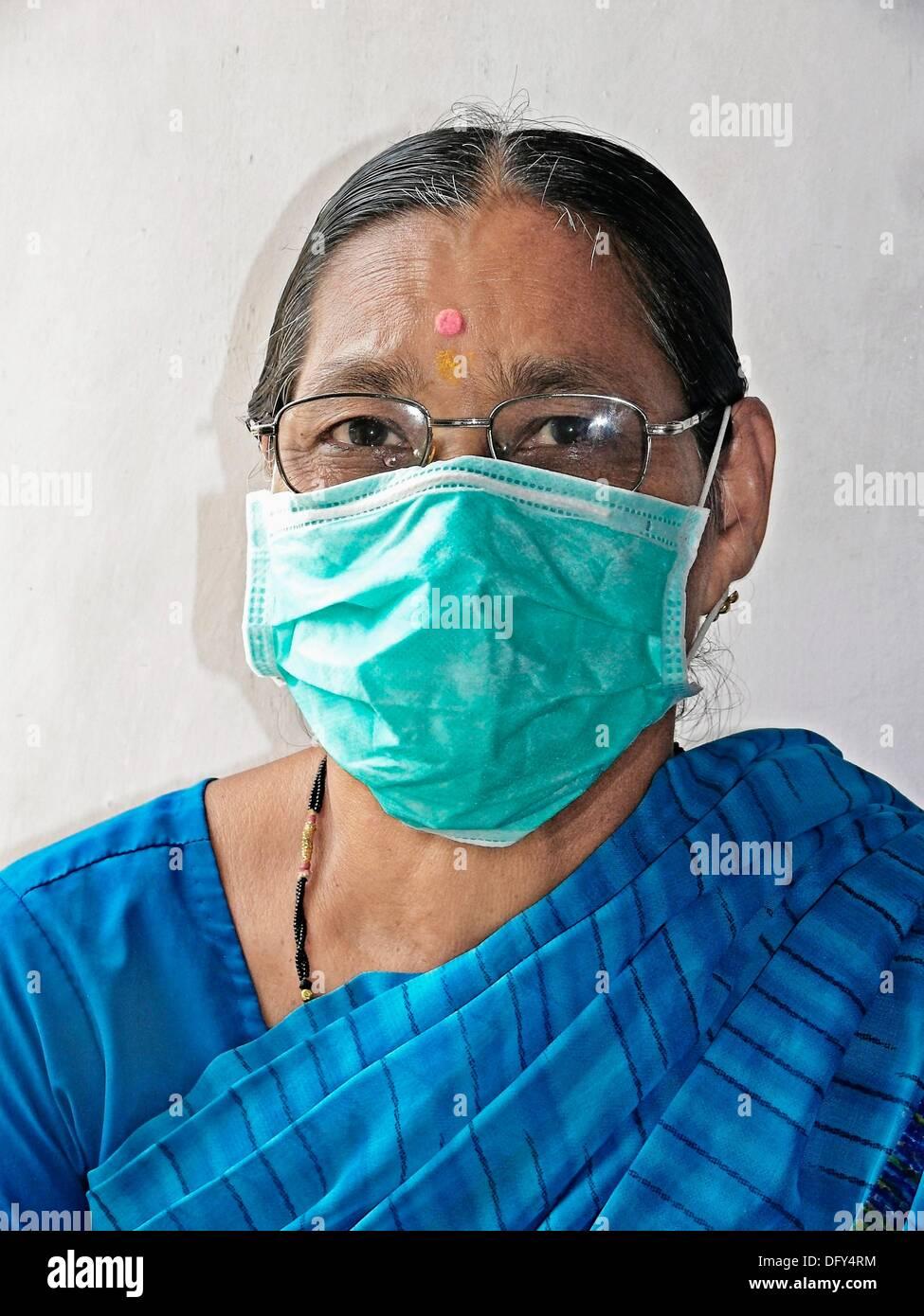 Adult Woman, Precaution mask for Swine Flu, H1N1 - Stock Image