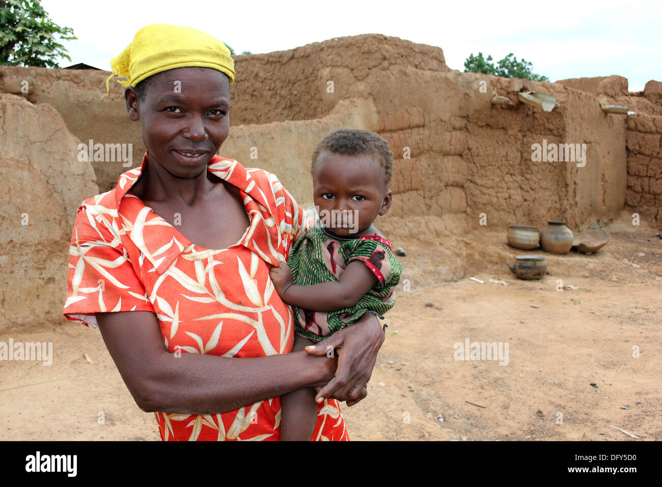 Mother And Baby Of The Lobi Ethnic Group of Ghana and Burkina Faso - Stock Image