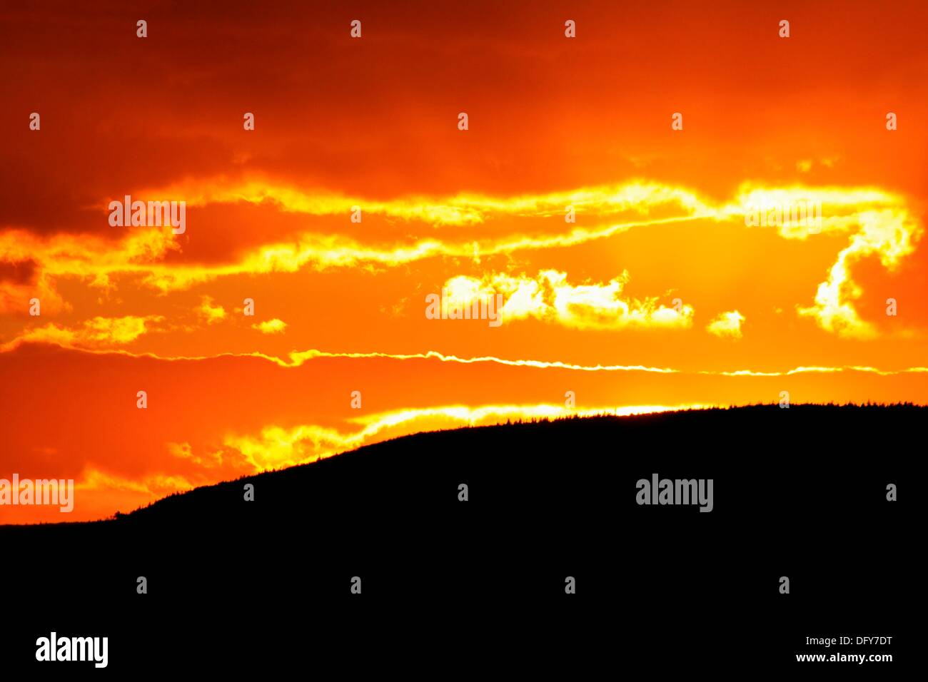 a blazing red sunset over Mt. Hermon - Stock Image