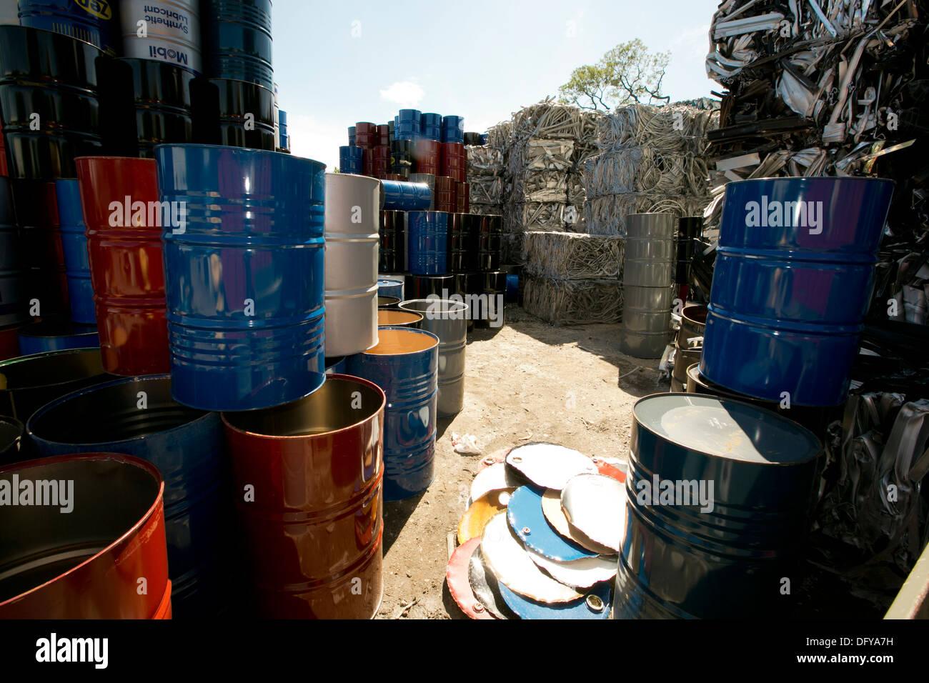 Metal oil barrels brought into scrap metal recycling yard in Texas - Stock Image
