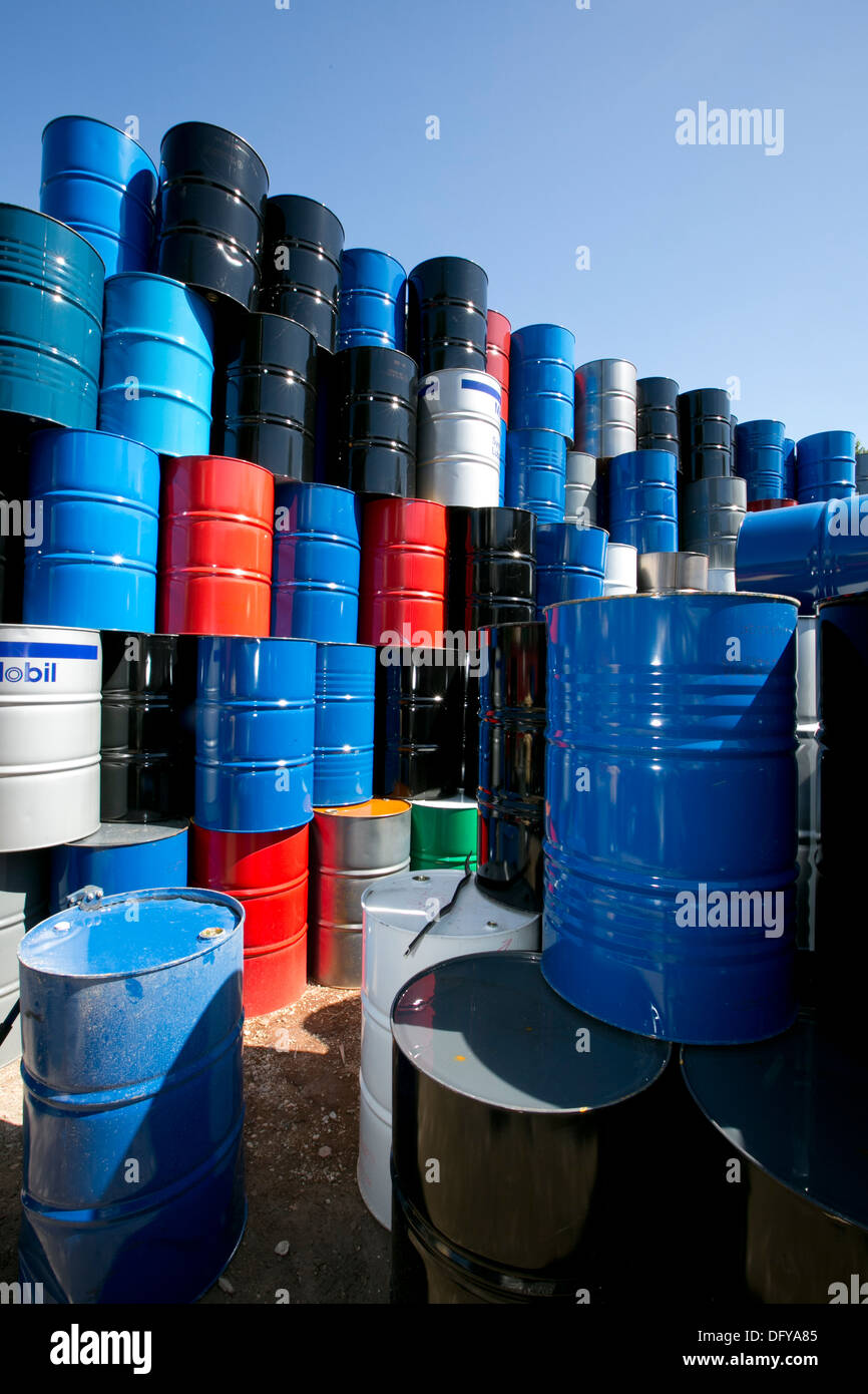 Metal oil barrels brought into scrap metal recycling yard in Texas - Stock Image