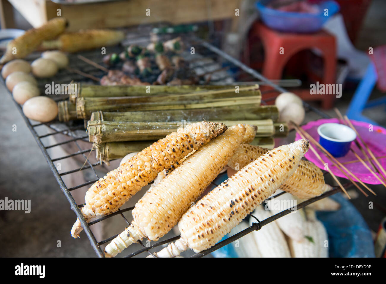 Vietnamese people sell the grill corn near the tourist sight , Sa Pa, Lao Cai, Vietnam - Stock Image