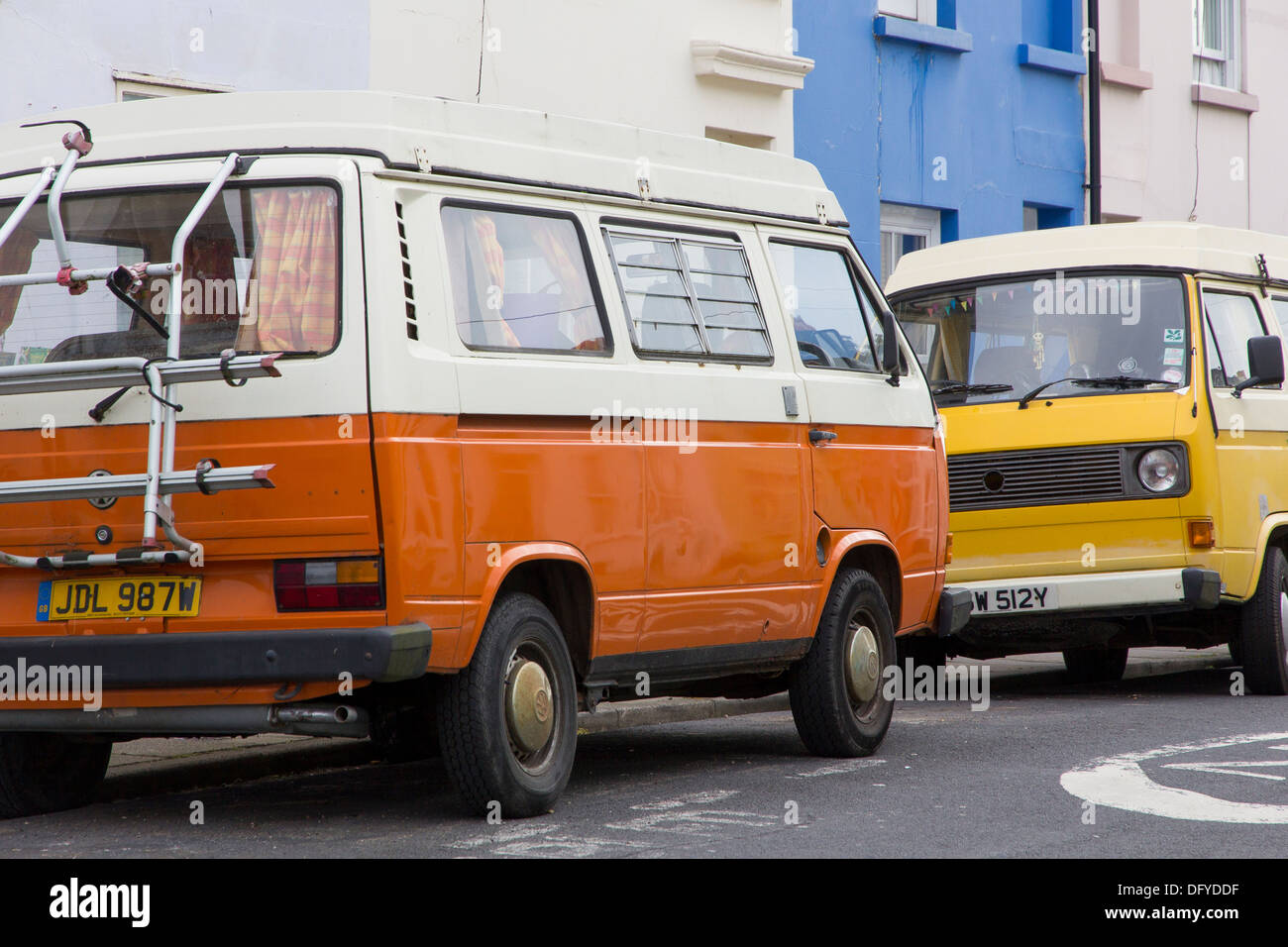 Two VW Transporter T25 camper vans parked on the street in the Hanover district of Brighton - Stock Image