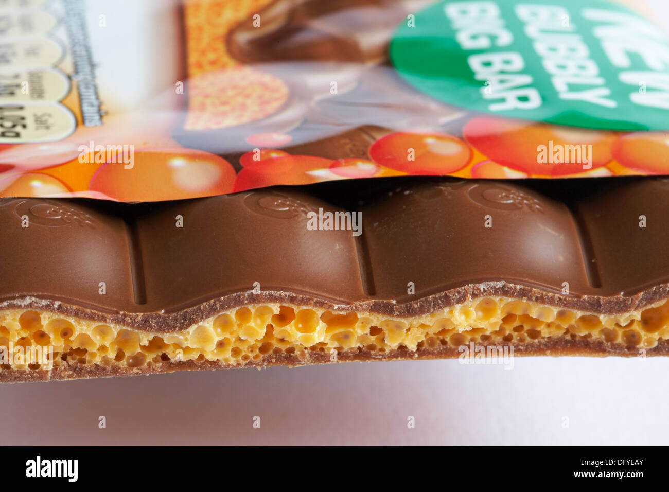 Nestle Orange aero new bubbly big bar of chocolate  with piece broken off to see inside set on white background - Stock Image