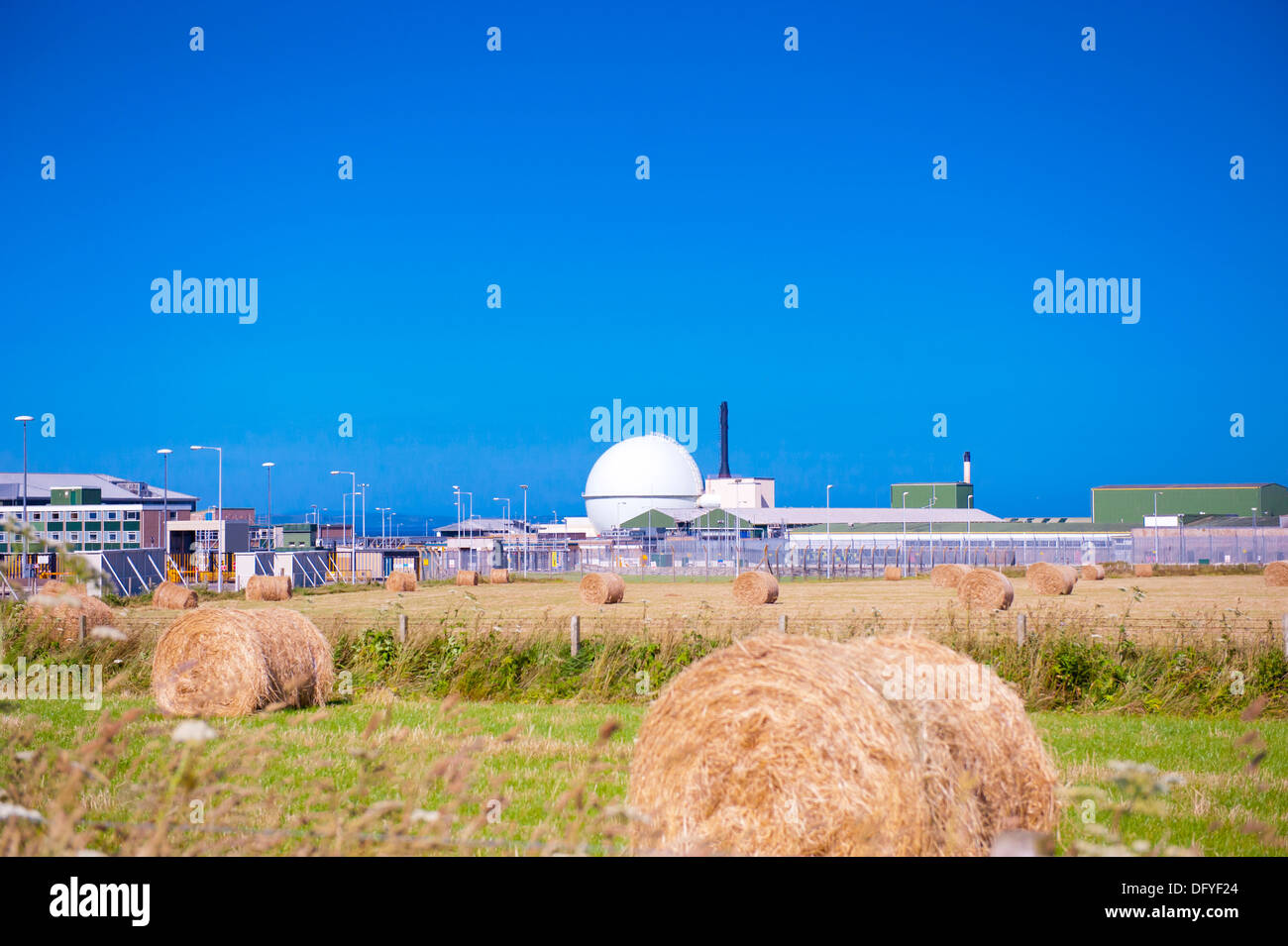 Dounreay nuclear power plant and haystacks Stock Photo