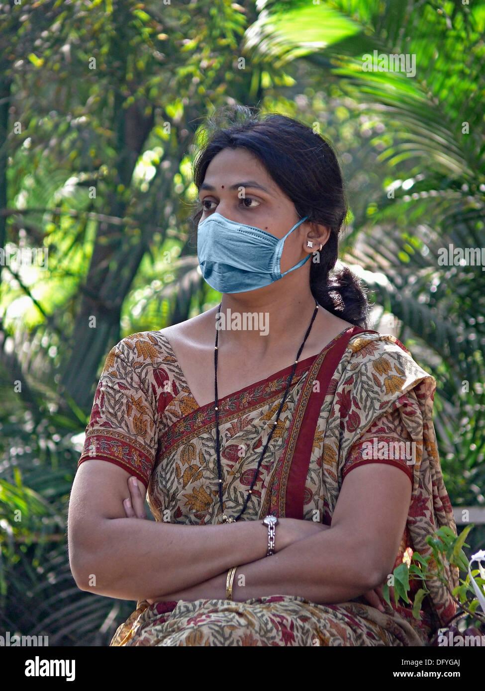 Woman, Precaution mask for Swine Flu, H1N1 - Stock Image