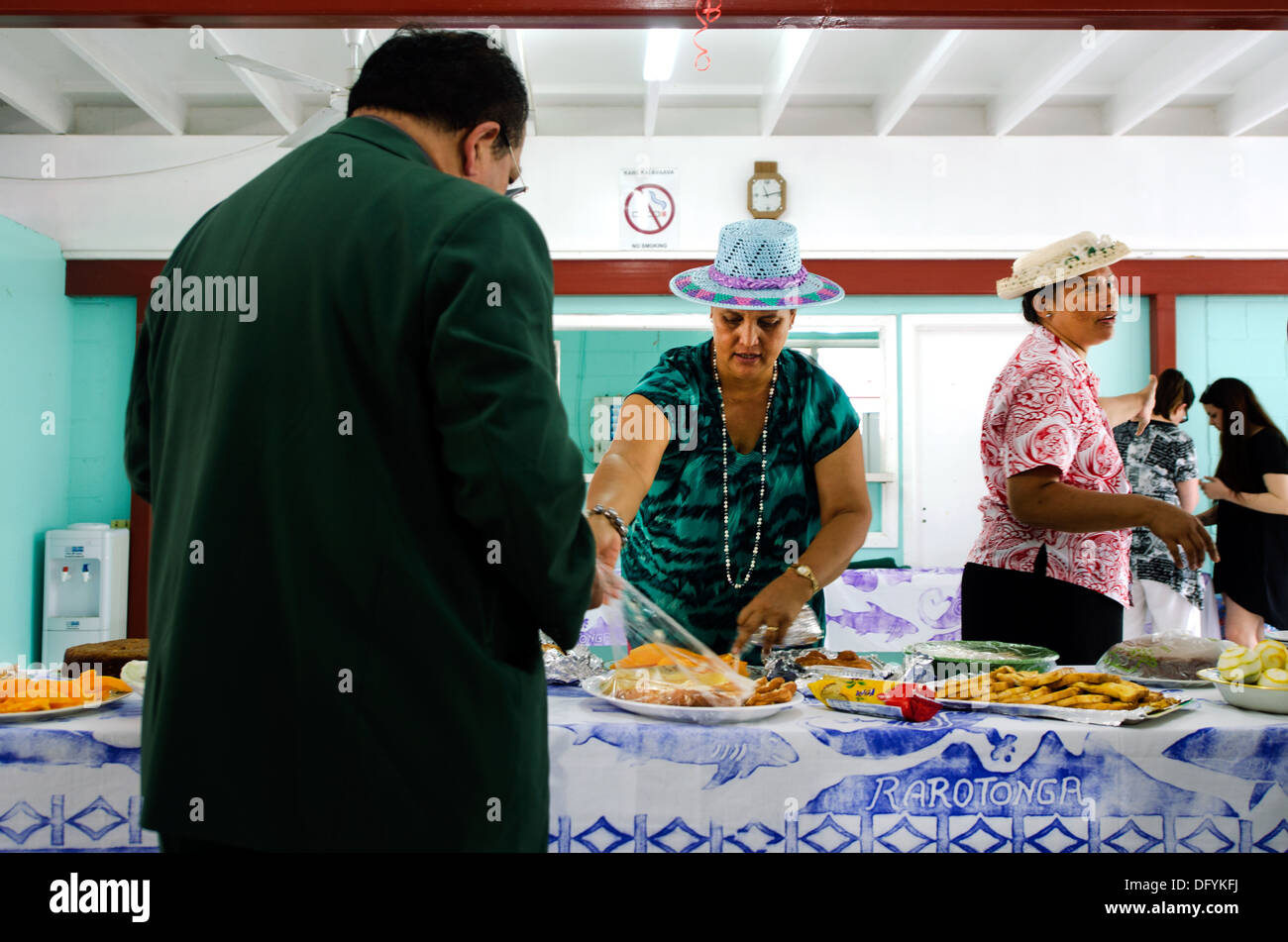 Cook Islands woman serve traditional food on Sunday morning tea at CICC church in Avarua Cook Islands - Stock Image
