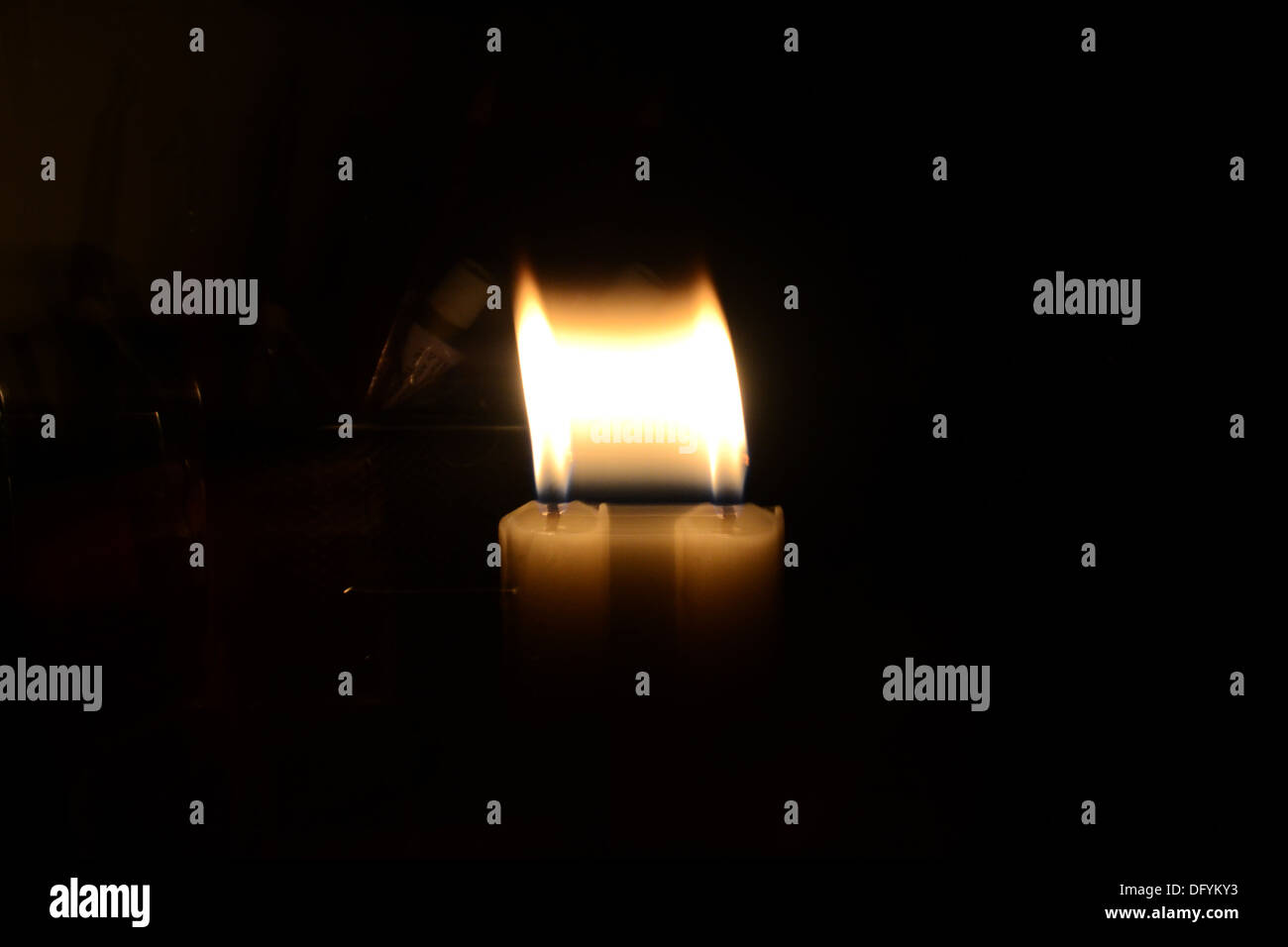 Experimenting with a candle flame, giving it a replicated look - Stock Image