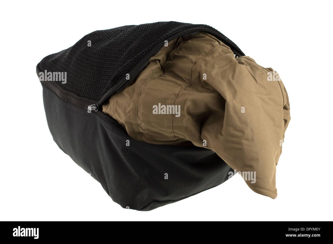 Clothing item stuffed into a zipped black stuff bag - Stock Image