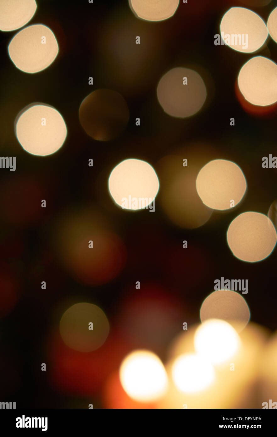 A blurred background with the bokeh of Christmas candles. - Stock Image