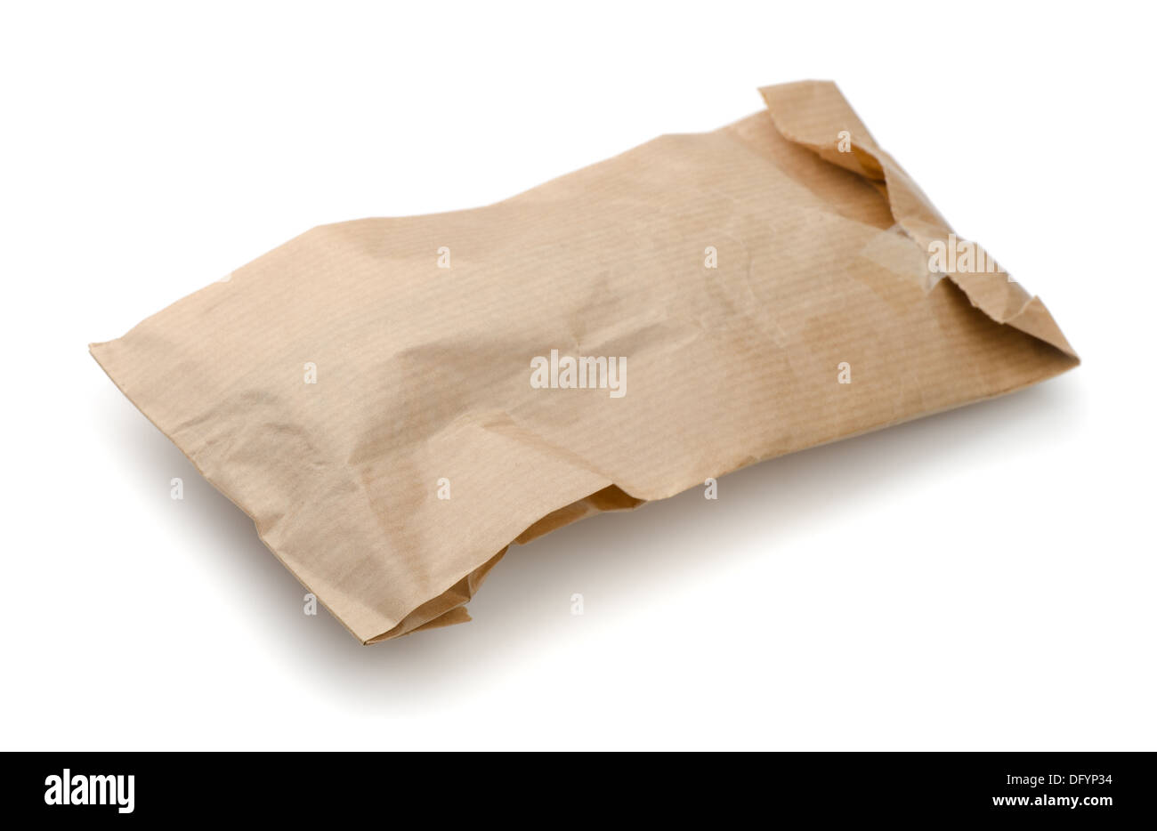 Closed crumpled paper package isolated on white - Stock Image