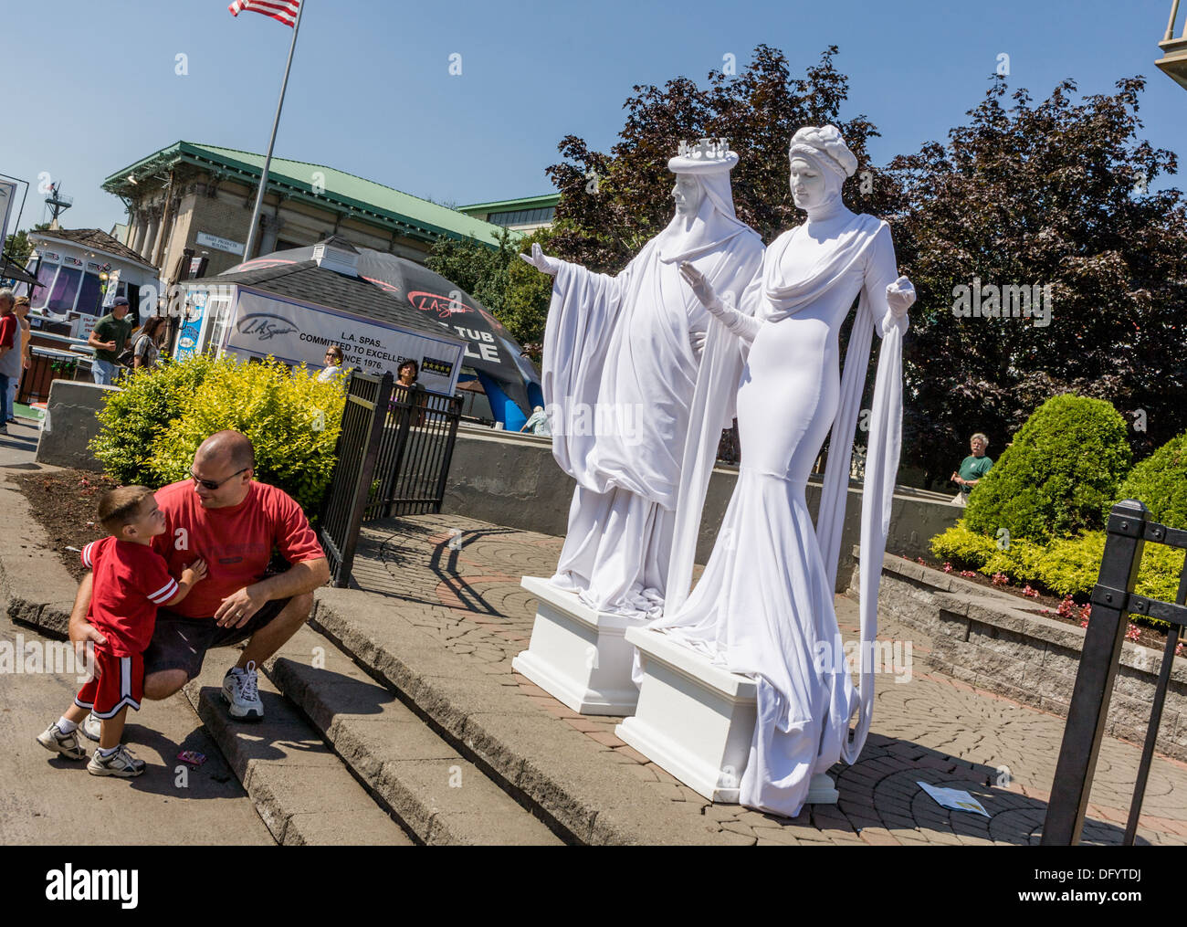 Little boy fascinated by Living Statues, Great New York State Fair, Syracuse. - Stock Image