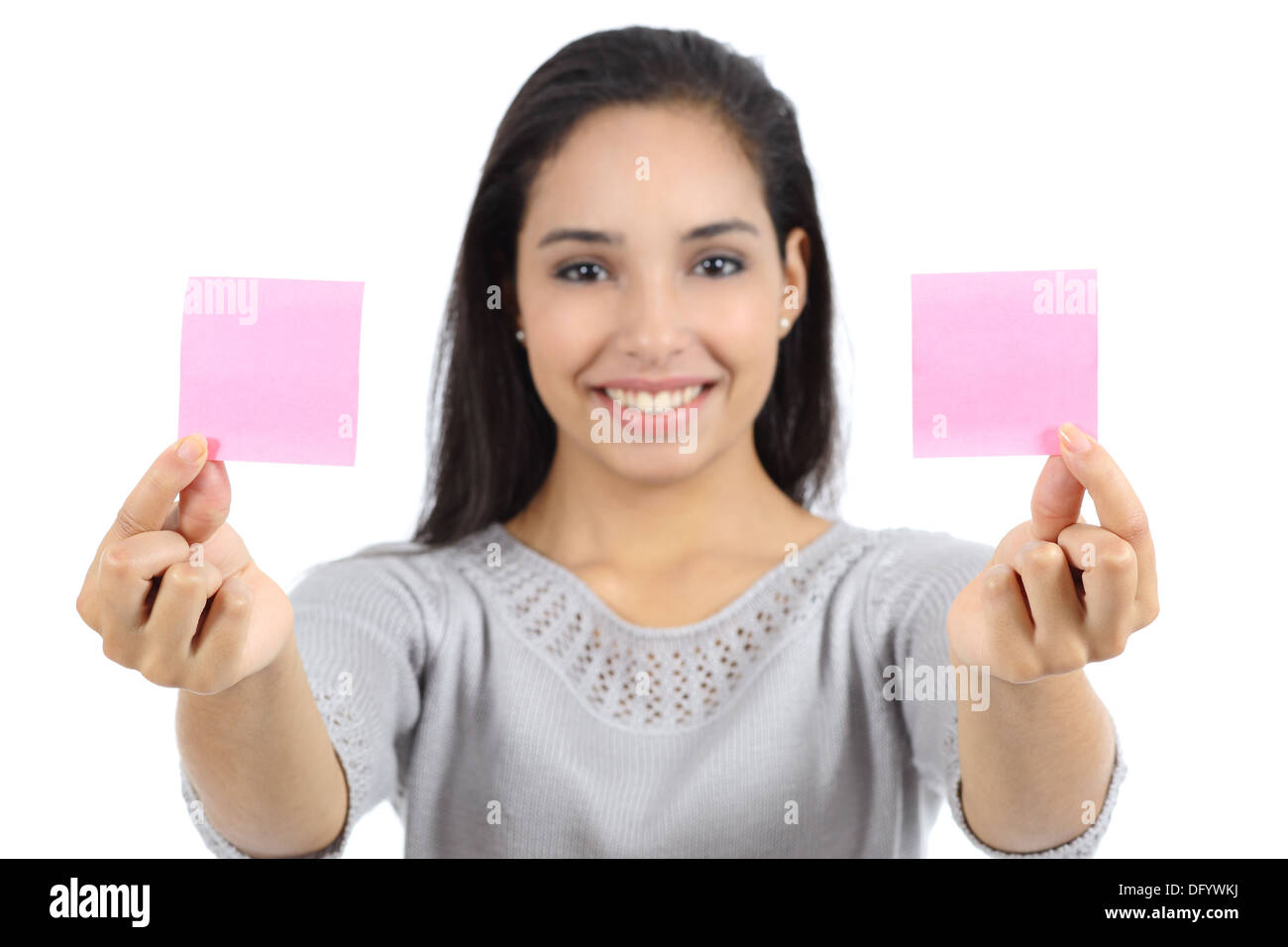 Woman showing two paper notes isolated on a white background - Stock Image