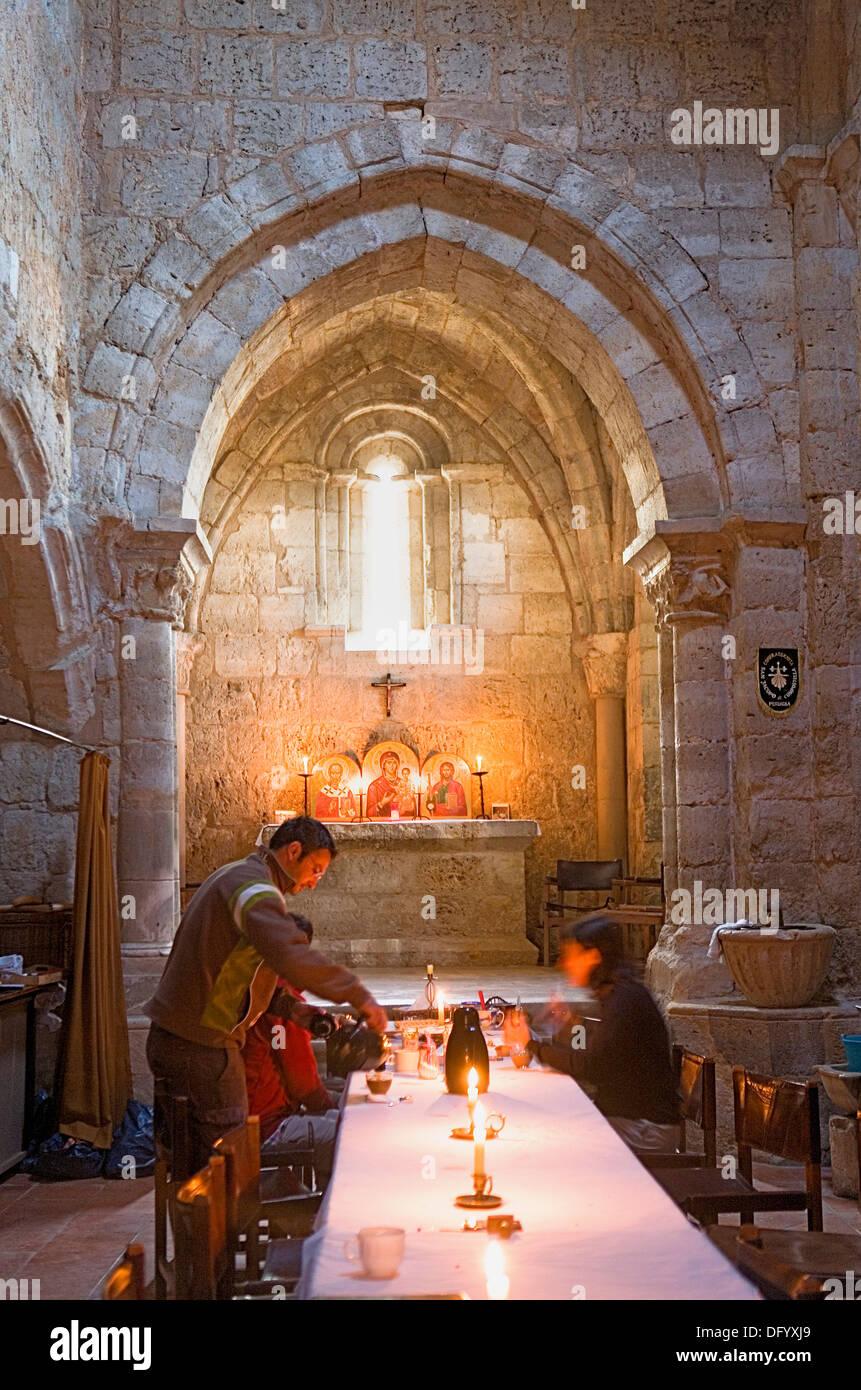Pilgrims taking breakfast in San Nicolas ermitage. Is a Pilgrim´s hostel.Burgos province.Spain. Camino de Santiago - Stock Image