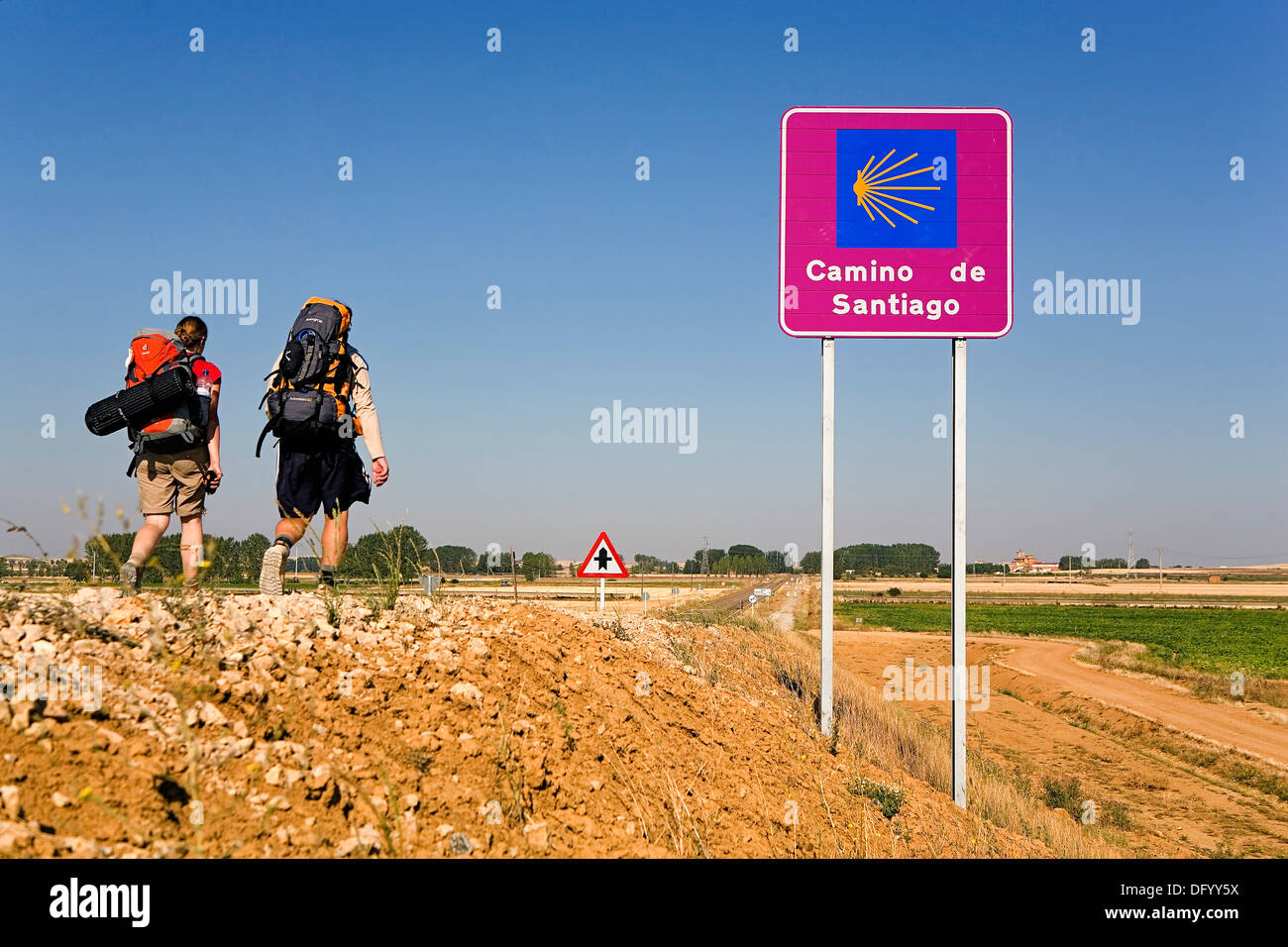 Pilgrims near Camino de Santiago sign. Near Frómista. Palencia province.Spain. Camino de Santiago - Stock Image