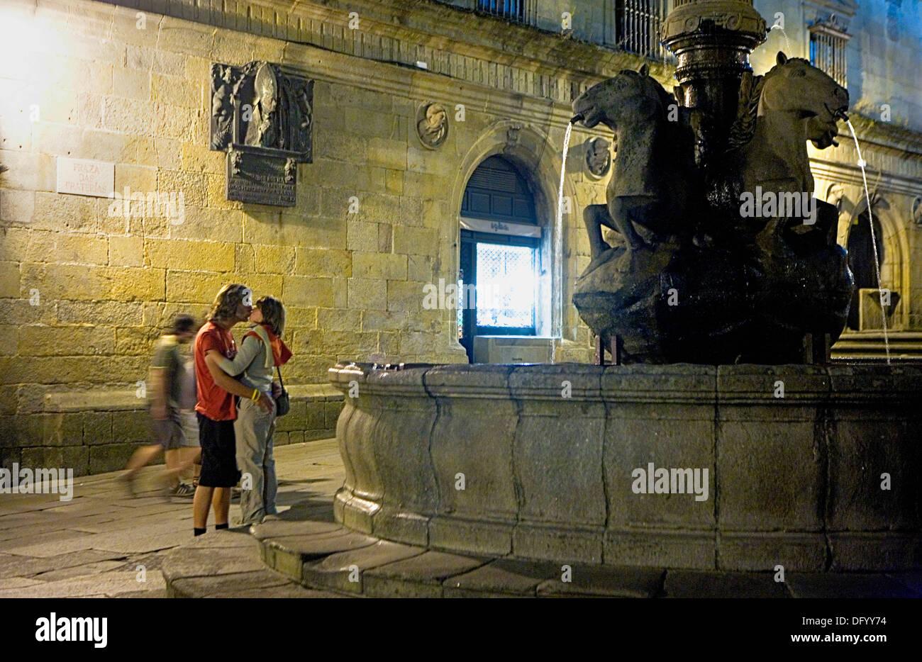 couple kissing in praza das Praterías. Santiago de Compostela.Coruña province.Spain. Camino de Santiago - Stock Image