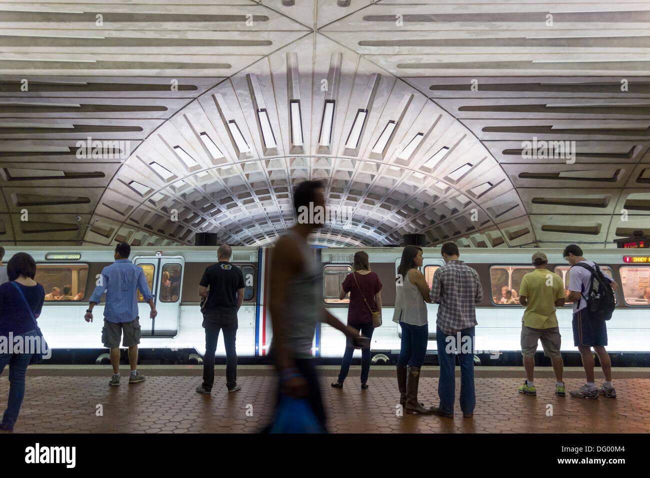 Metro Center subway station, Washington DC. People, tourists, waiting on the platform for the underground train to arrive. - Stock Image