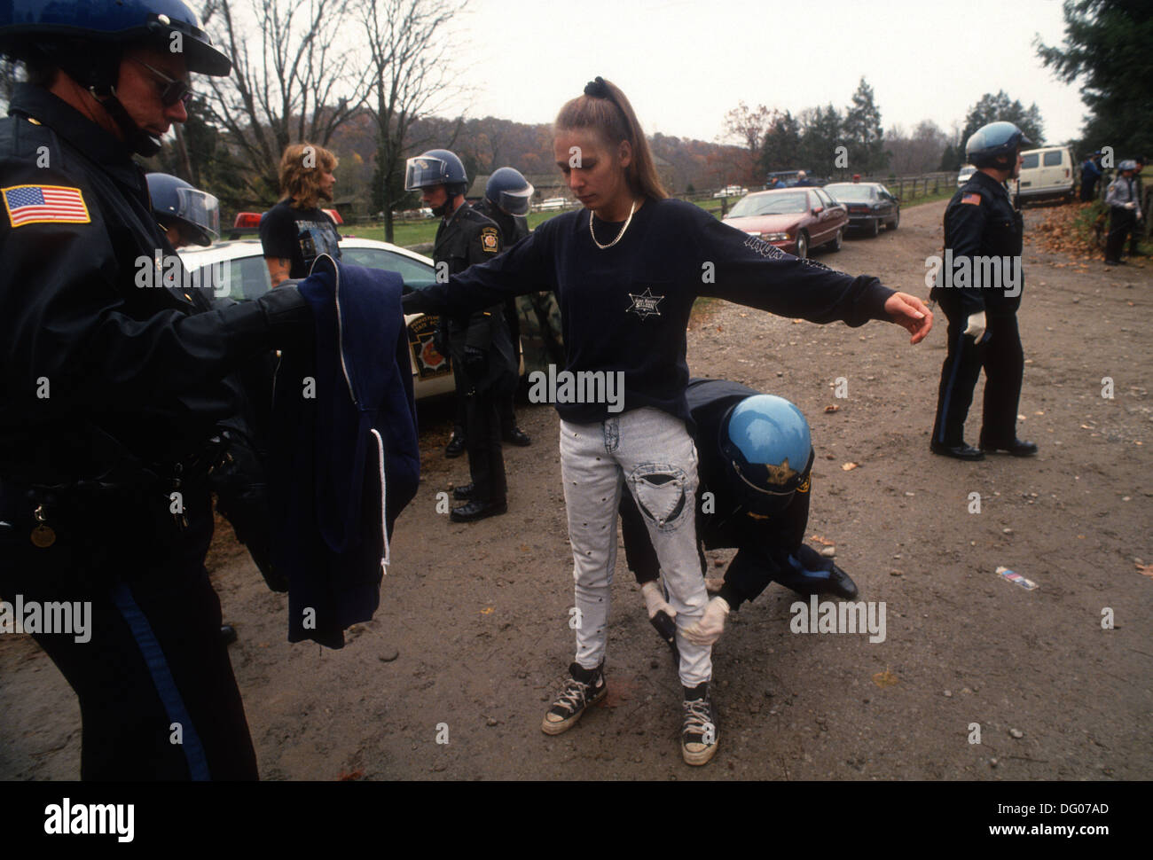 Washington's Crossing, PA - 6 Nov 1993 Pennsylvania State Police stop and frisk a female skinhead for weapons. - Stock Image