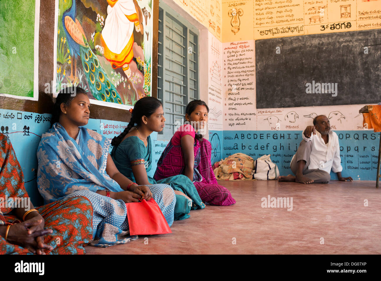 Indian women waiting outside Pediatric clinic at Sri Sathya Sai Baba mobile outreach hospital. Andhra Pradesh, India - Stock Image