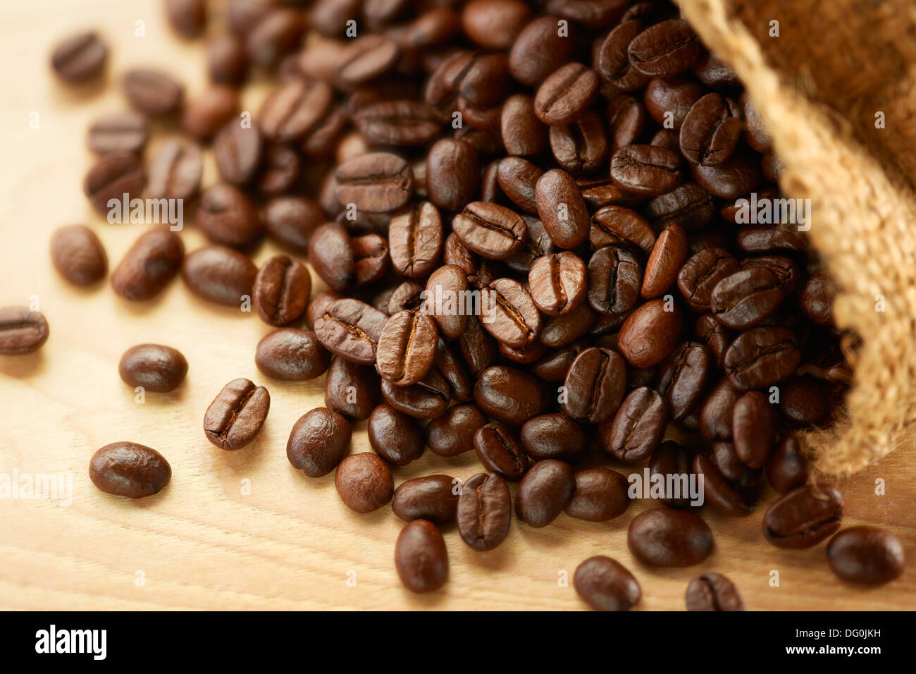 coffee beans with sack bag, shallow depth of field - Stock Image