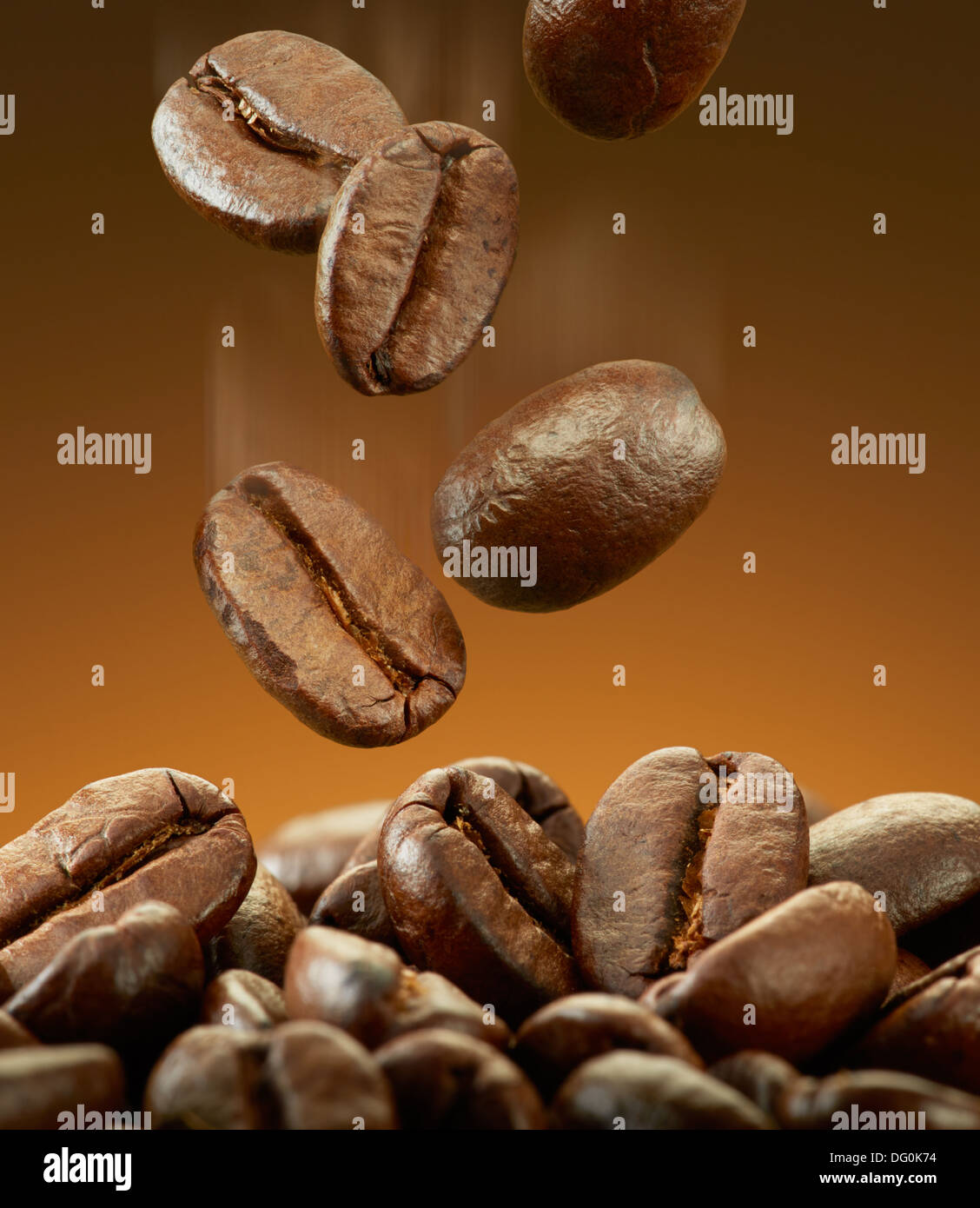 coffee beans falling on pile with motion blur - Stock Image