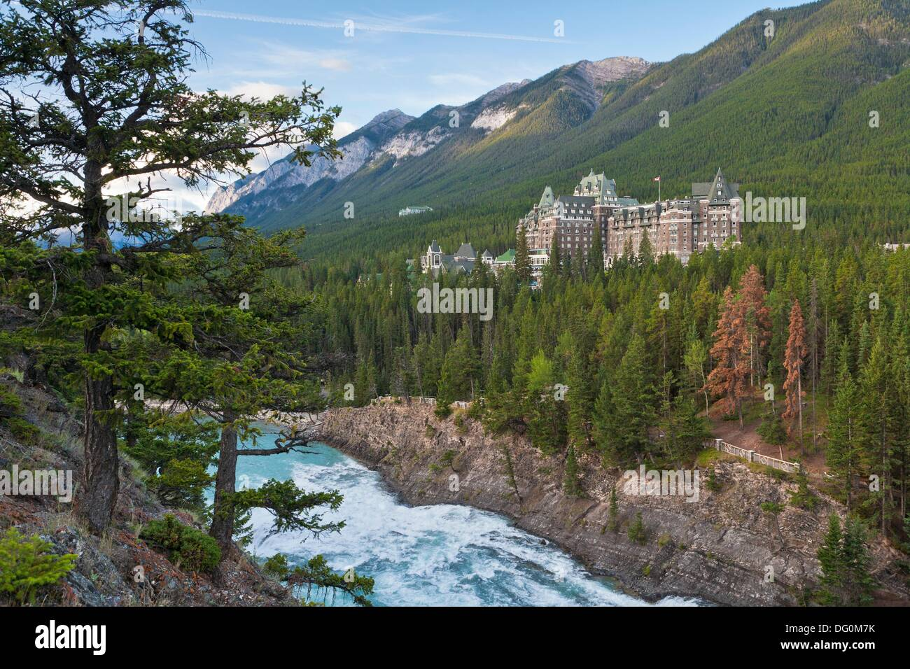 The imposing Banff Springs Hotel with Bow River, Banff National Park, Alberta, Canada - Stock Image