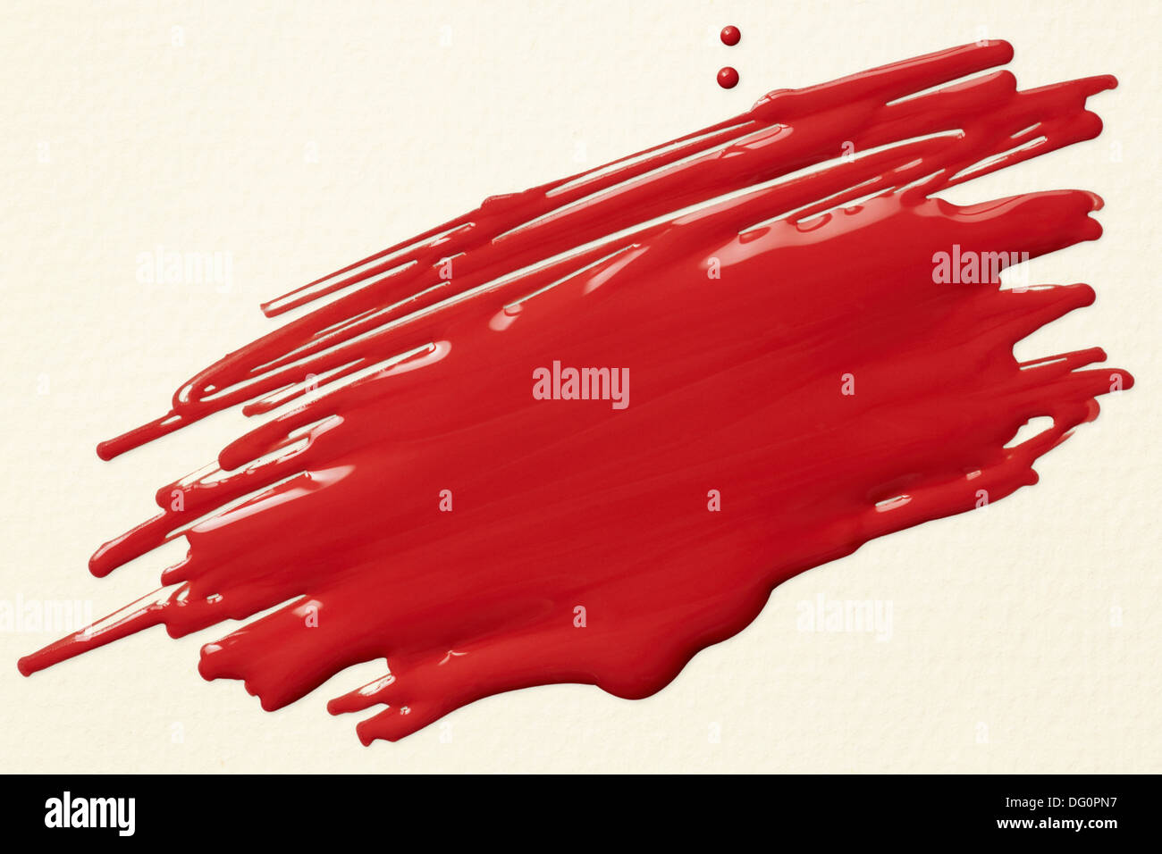 red paint scribble on white textured paper - Stock Image