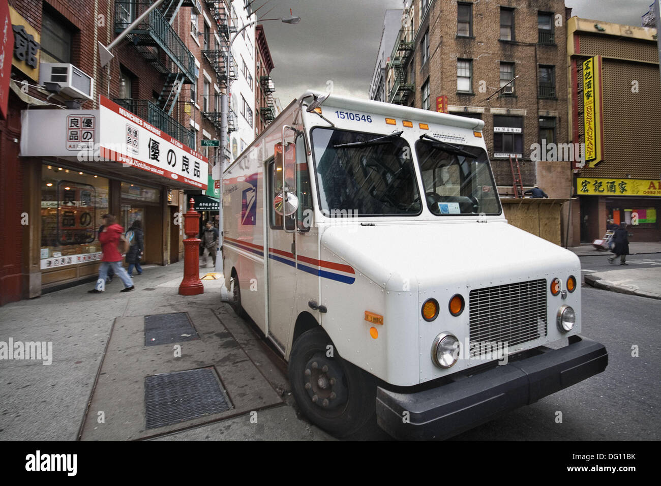 Postal service car in Chinatown, Manhattan, NYC, USA - Stock Image