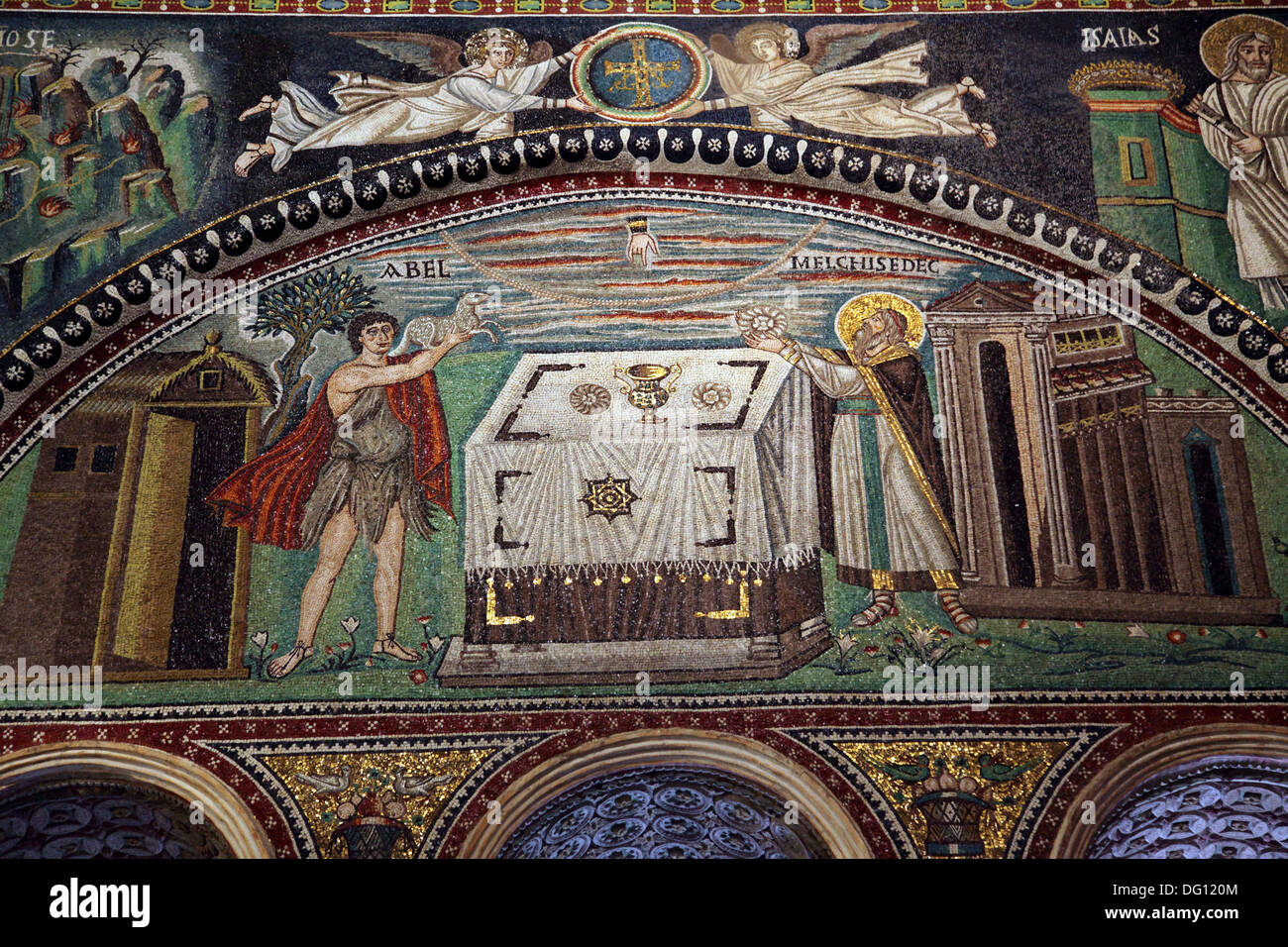 Mosaics on the wall showing Abel sacrificing a lamb and Melchizedek sacrificing bread in the Basilica di San Vitale in Ravenna, - Stock Image